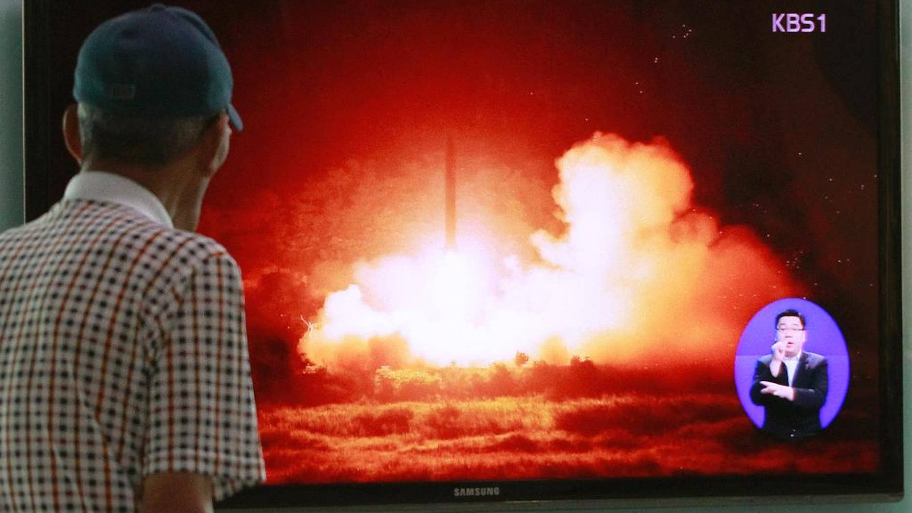 A man watches a TV news program showing a file picture of a missile launch conducted by North Korea, at Seoul Railway Station in Seoul, South Korea, Sunday, July 13, 2014.  North  Korea launched ballistic missiles into the sea on Sunday, South Korea said, the latest in a series of test-firings seen as expressions of anger over the North's failure to win talks on receiving outside aid, and over ongoing U.S.-South Korean military drills. (AP Photo/Ahn Young-joon)