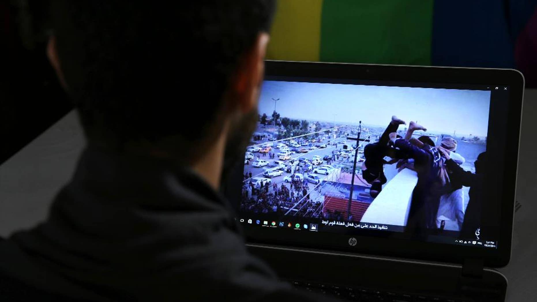 Daniel Halaby, a gay Syrian living in southern Turkey, shows a photo from his laptop of ISIS militants throwing a man off a roof allegedly for violating the extremists' ban on homosexuality.
