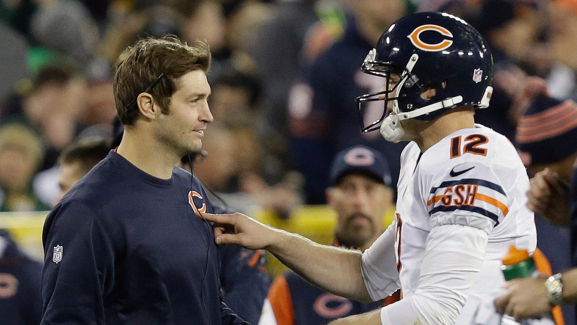 Chicago Bears quarterback Josh McCown (12) talks to Jay Cutler during the first half of an NFL football game against the Green Bay Packers Monday, Nov. 4, 2013, in Green Bay, Wis. (AP Photo/Mike Roemer)