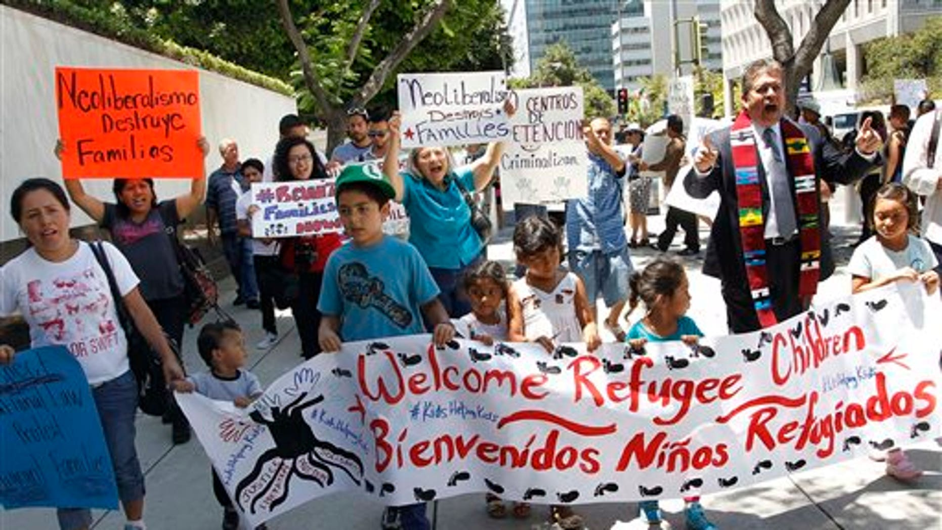 Immigrant families and children's advocates rally outside the Los Angeles Federal building Monday, July 7, 2014.