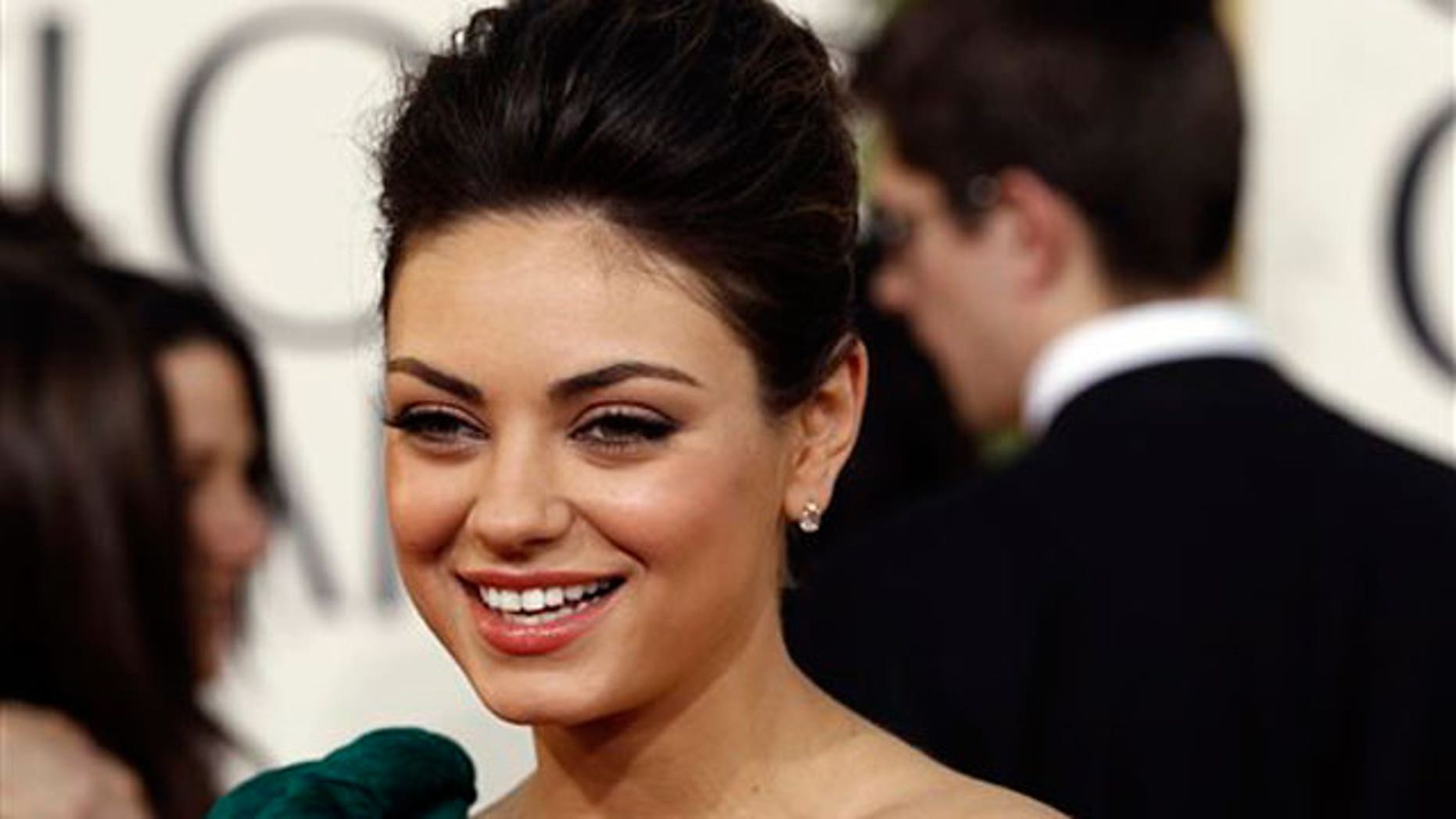 Jan. 16: Mila Kunis walks the red carpet at the Golden Globe Awards.