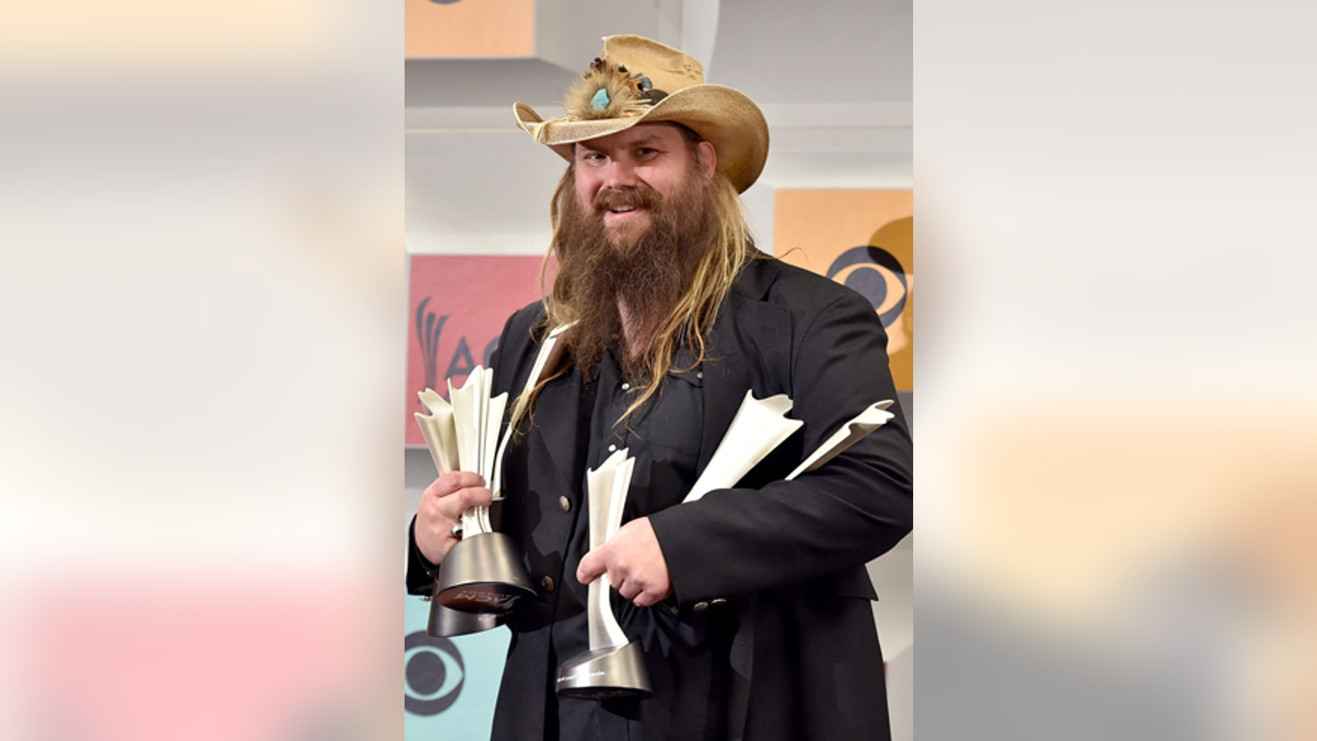 """Chris Stapleton poses in the press room with the awards for album of the year for """"Traveller"""", new male vocalist of the year, male vocalist of the year and song of the year for Nobody to Blame, at the 51st annual Academy of Country Music Awards at the MGM Grand Garden Arena on Sunday, April 3, 2016, in Las Vegas."""