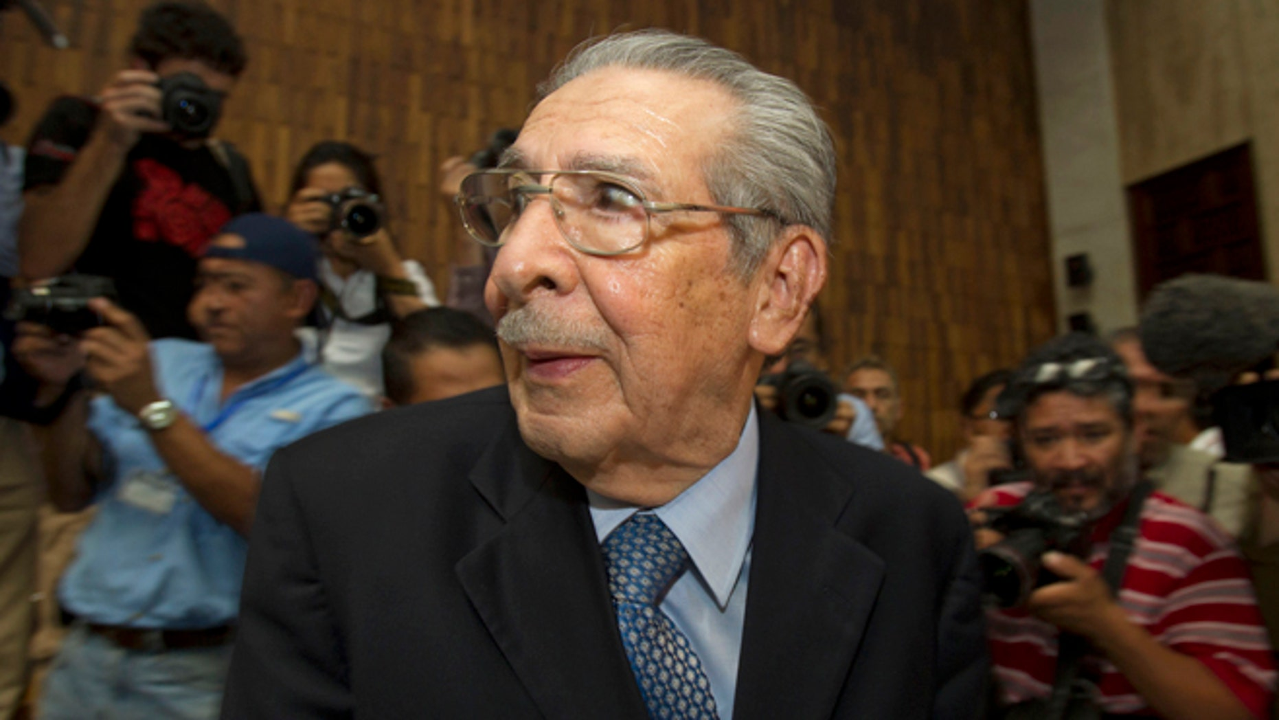 FILE - In this Friday, May 10, 2013 file photo, Guatemala's former dictator Jose Efrain Rios Montt wears headphones as he listens to the verdict in his genocide trial in Guatemala City.