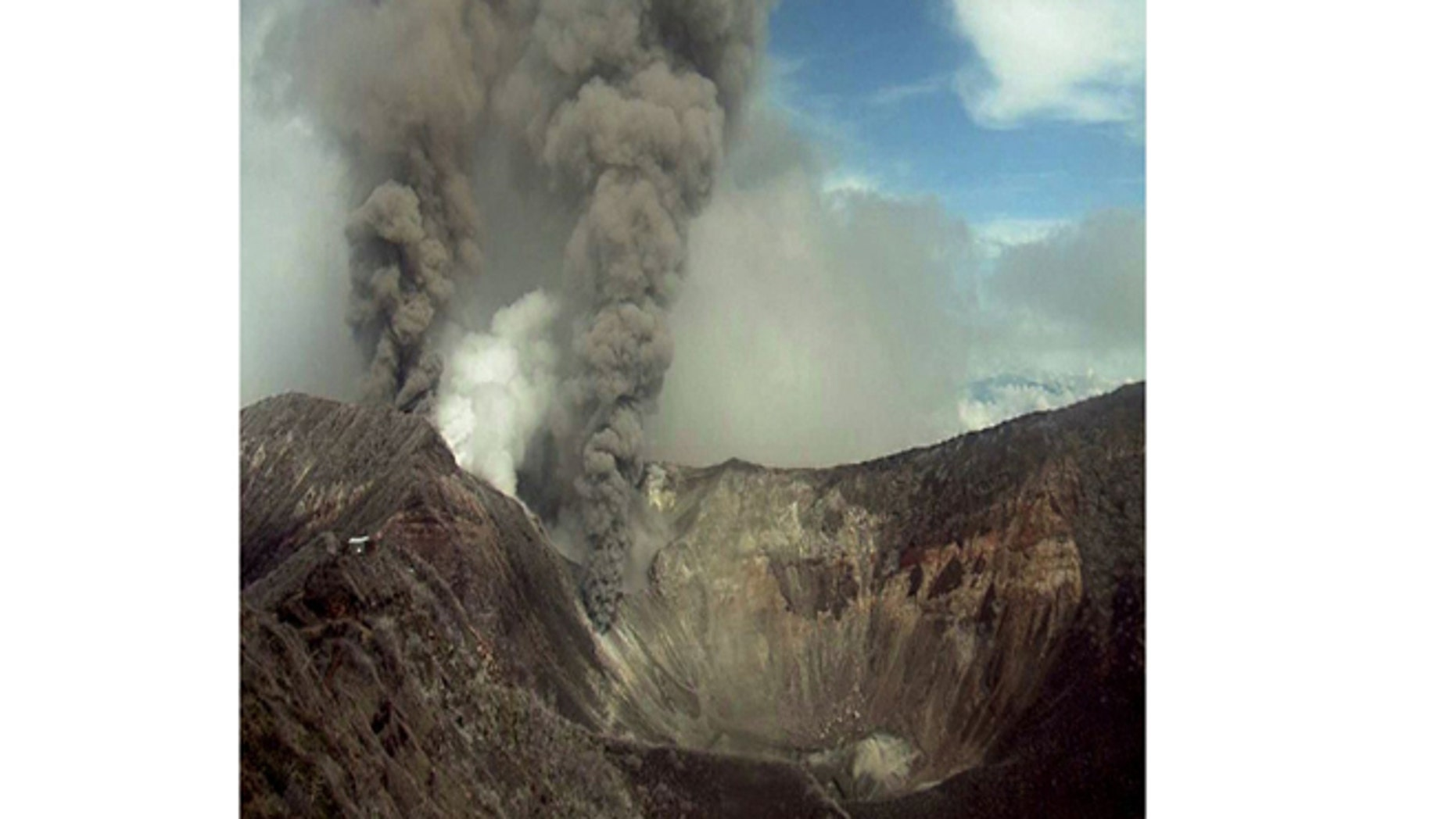 May 21, 2013: In this image provided by the Volcanological and Seismological Observatory of Costa Rica, the Turrialba volcano emits an ash-filled gas plume in Costa Rica.