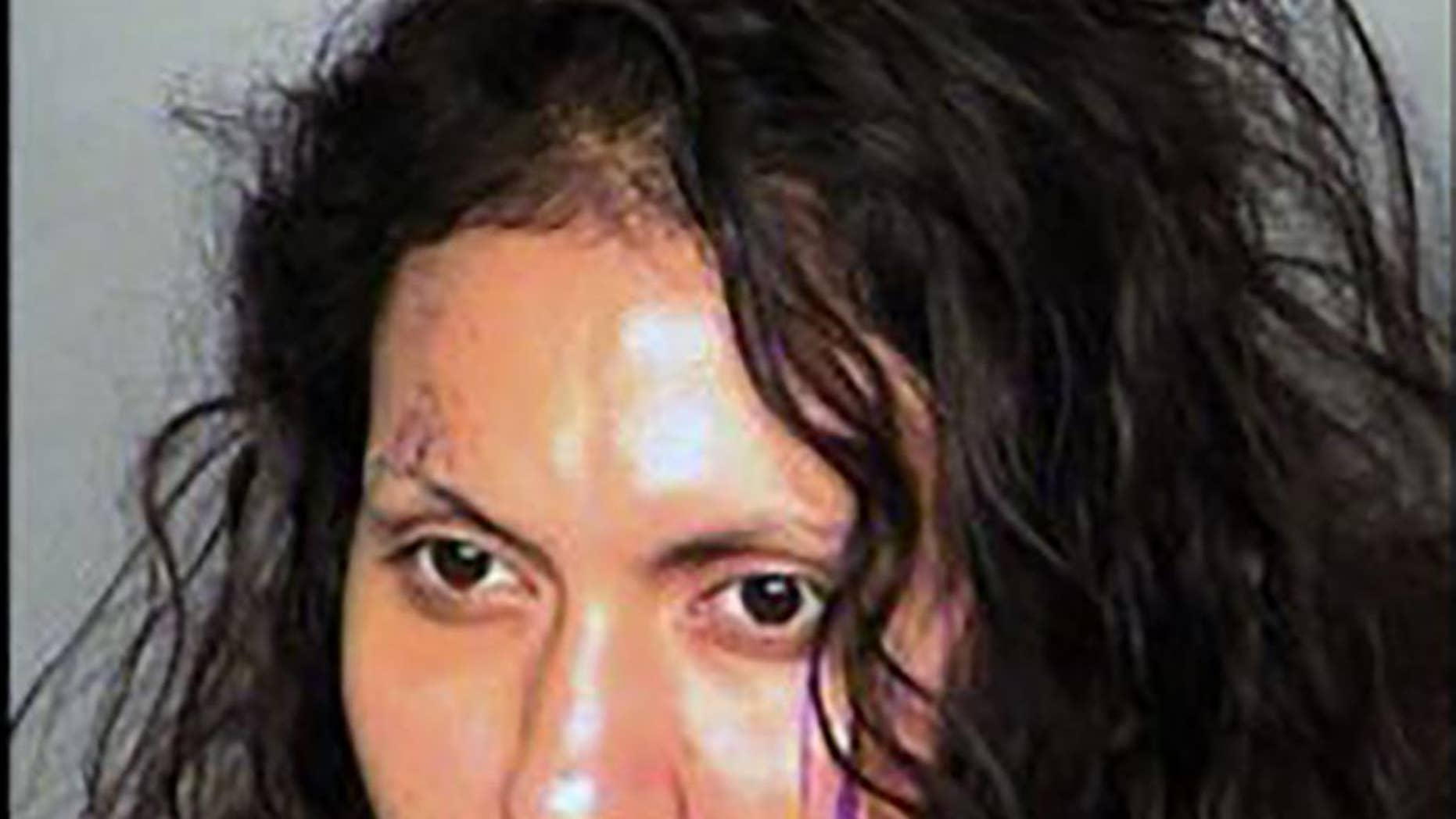 FILE - This undated booking photo provided by the Las Vegas Metropolitan Police Department shows Luz Robledo Ibarra. On Friday, Sept. 26, 2014, defense lawyer Benson Lee says he will fight a finding that Ibarra, 34, is fit for trial on charges alleging she threw her 7-month-old son and 1½-year-old daughter out a second-story window before jumping out herself. (AP Photo/Las Vegas Metropolitan Police Department, File)