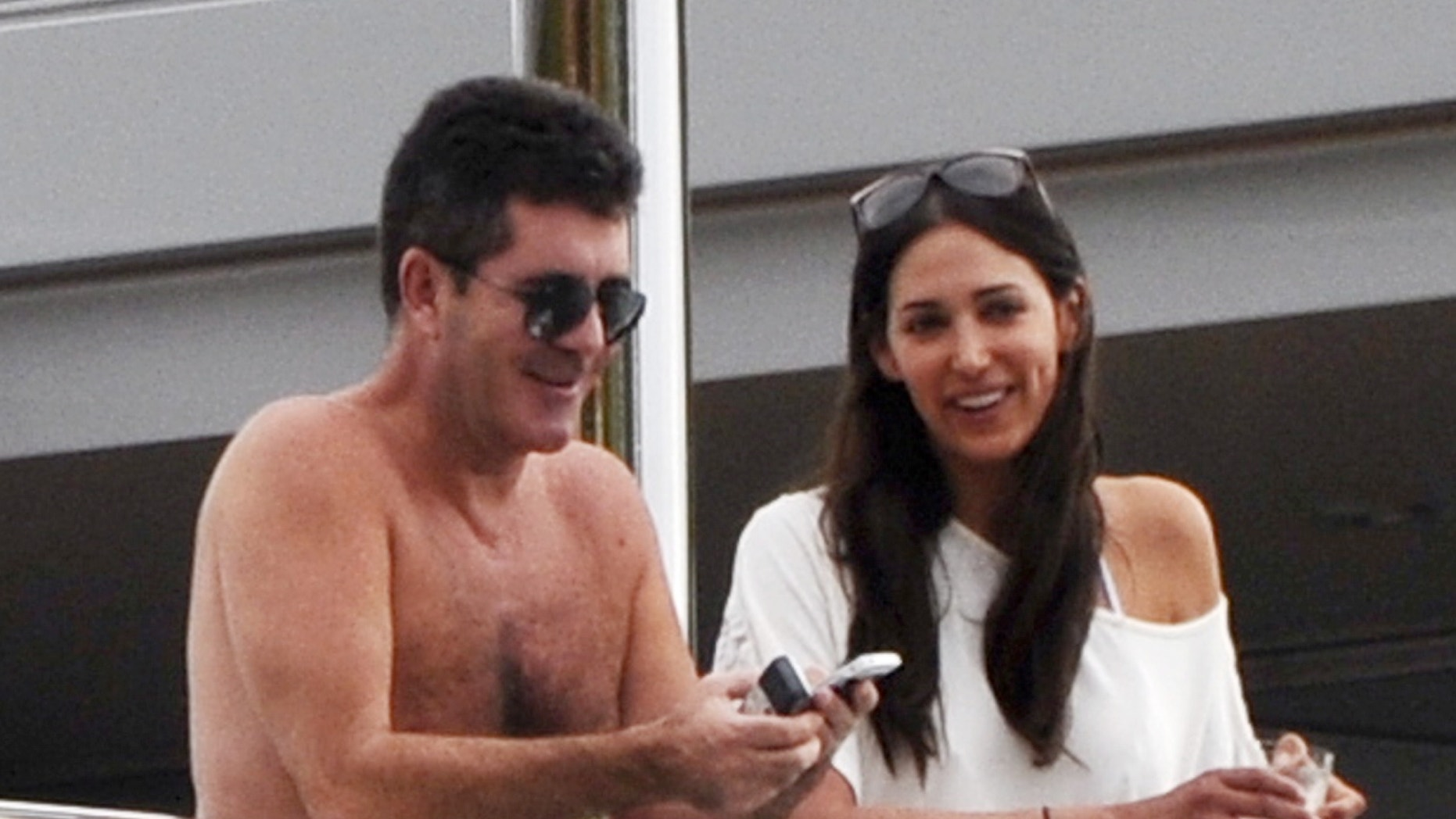 Simon Cowell soaking up the sun with Lauren Silverman in Saint Barths on January 4, 2012.