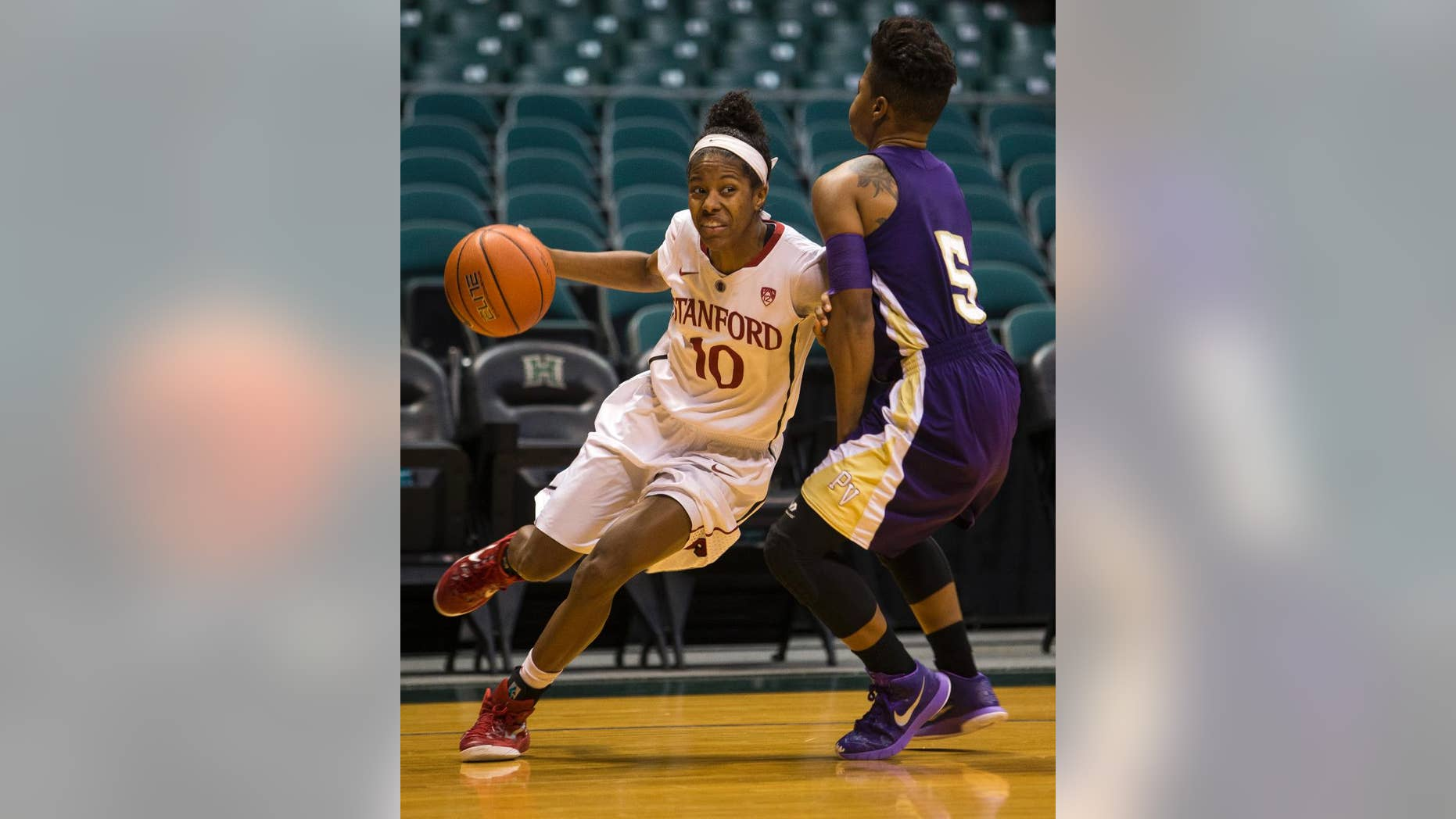 Stanford guard Briana Roberson (10) drives past Prairie View A&M Shaneece Stephens during the first half of an NCAA college basketball game, Sunday, Nov. 30, 2014 in Honolulu.  (AP Photo/Marco Garcia)