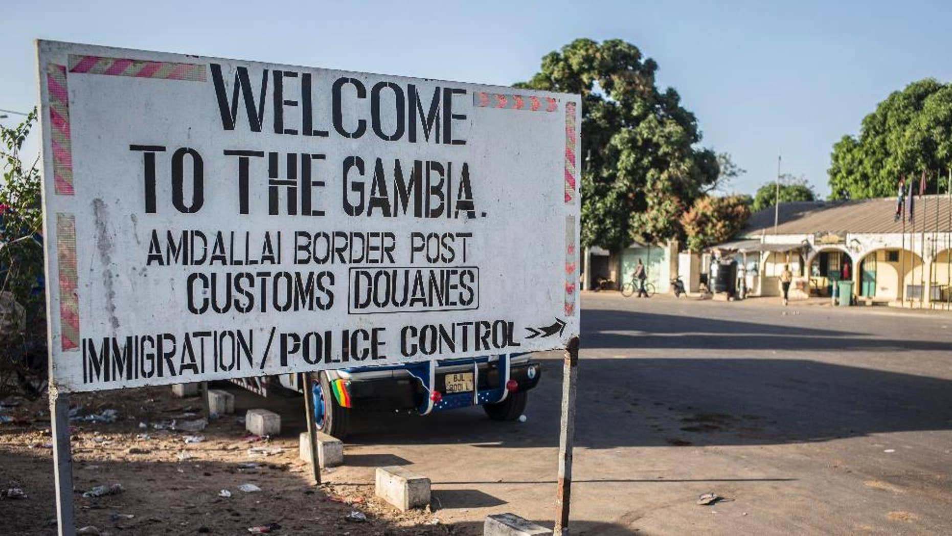 A sign at the border crossing between Gambia and Senegal near the town of Karang, Senegal, Thursday, Jan. 19, 2017. Gambia's president-elect said Thursday he will be sworn into office at the Gambian Embassy in neighboring Senegal, while there was no word from longtime leader Yahya Jammeh on the day that his mandate expired. (AP Photo/Sylvain Cherkaoui)