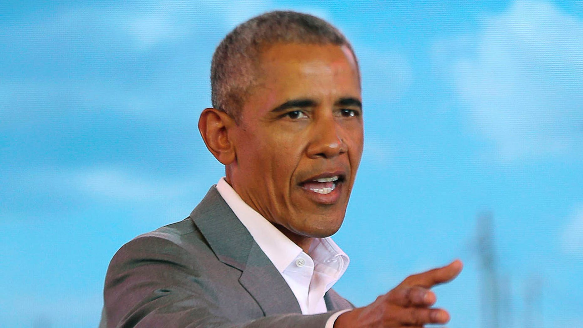 Former US President Barack Obama gestures to the crowd, during an event in Kogelo, Kisumu, Kenya, Monday, July 16, 2018. Obama is in Kenya to launch a sports and training center founded by his half-sister, Auma Obama. (