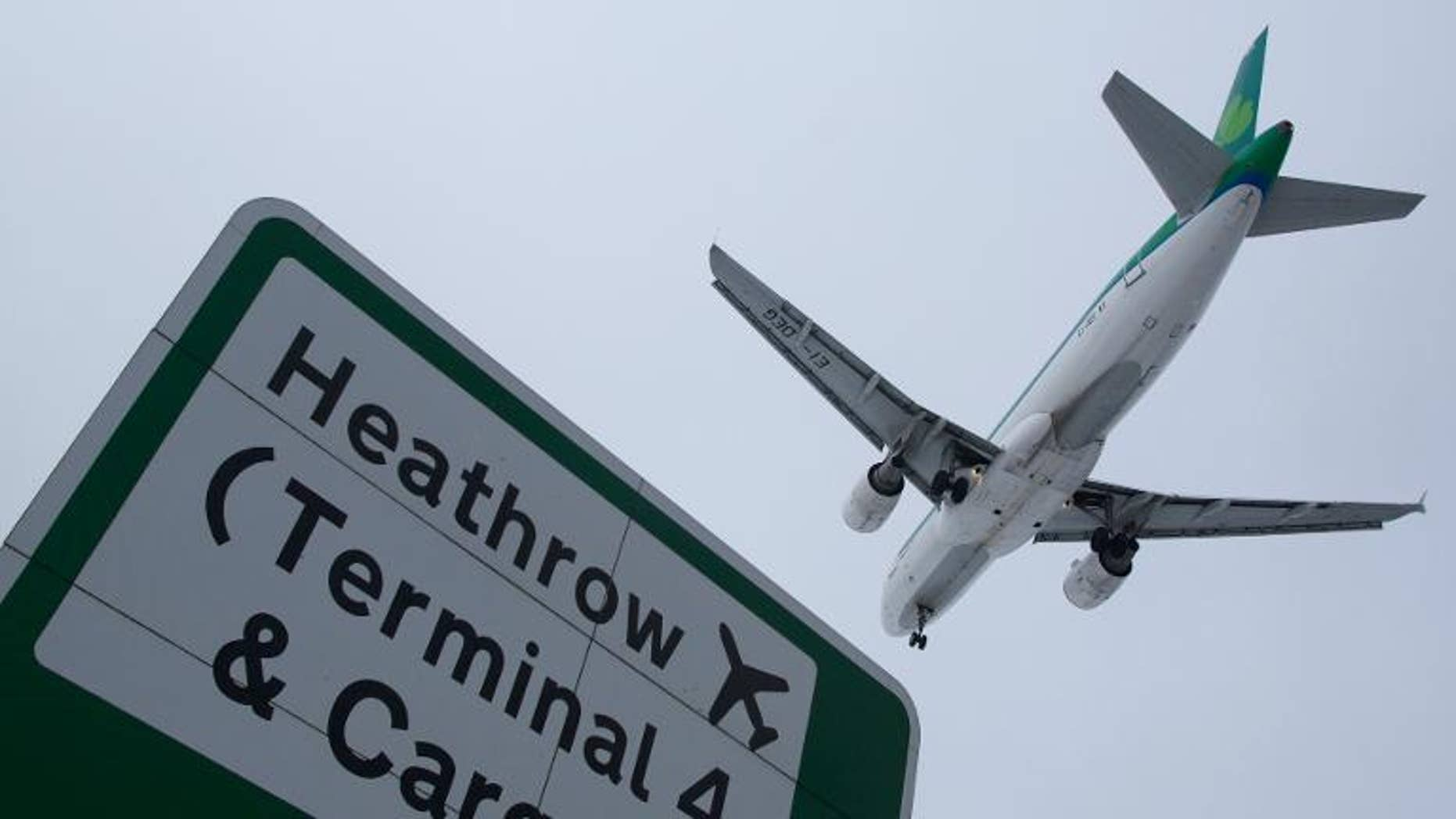 A plane flies in to land at Heathrow airport in west London on January 21, 2013