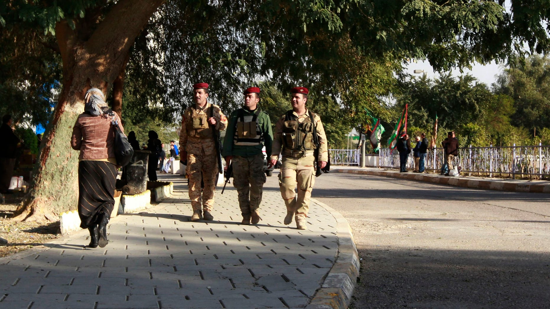 Dec. 18, 2012: Iraqi Presidential guards walk outside the hospital where Iraqi president Jalal Talabani is receiving treatment at the Medical City in Baghdad, Iraq.