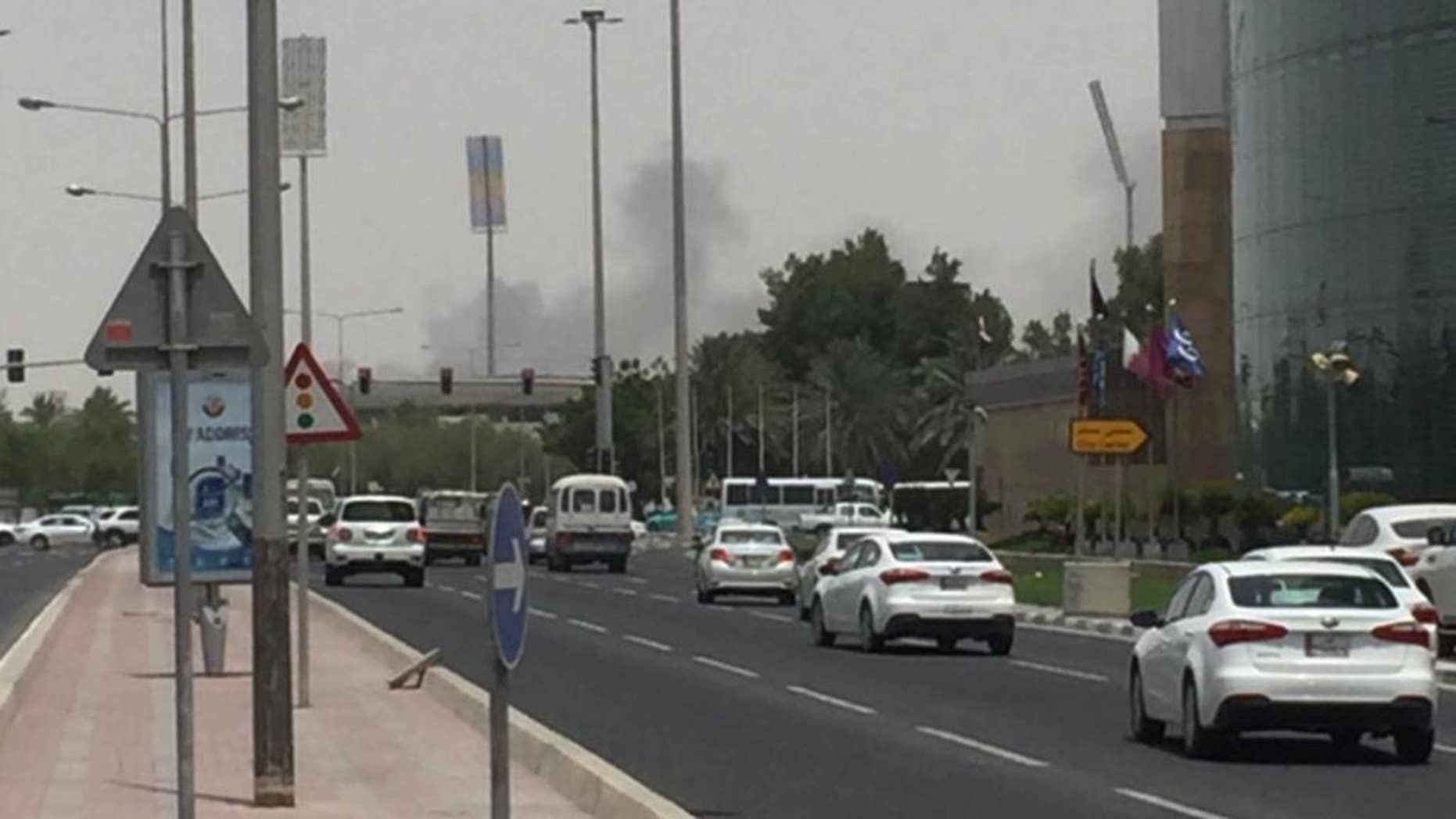 This picture posted on social media shows thick black smoke billowing from the Tawar Mall complex, Wednesday, July 20, 2016. Authorities say a fire has broken out at a shopping mall under construction in the country's capital, the second such blaze in the 2020 World Cup host nation in less than four months. The Ministry of Interior said firefighters had contained the fire near the Dahl al-Hamam park. No casualties were reported. (Haris Aghadi Twitter via AP)