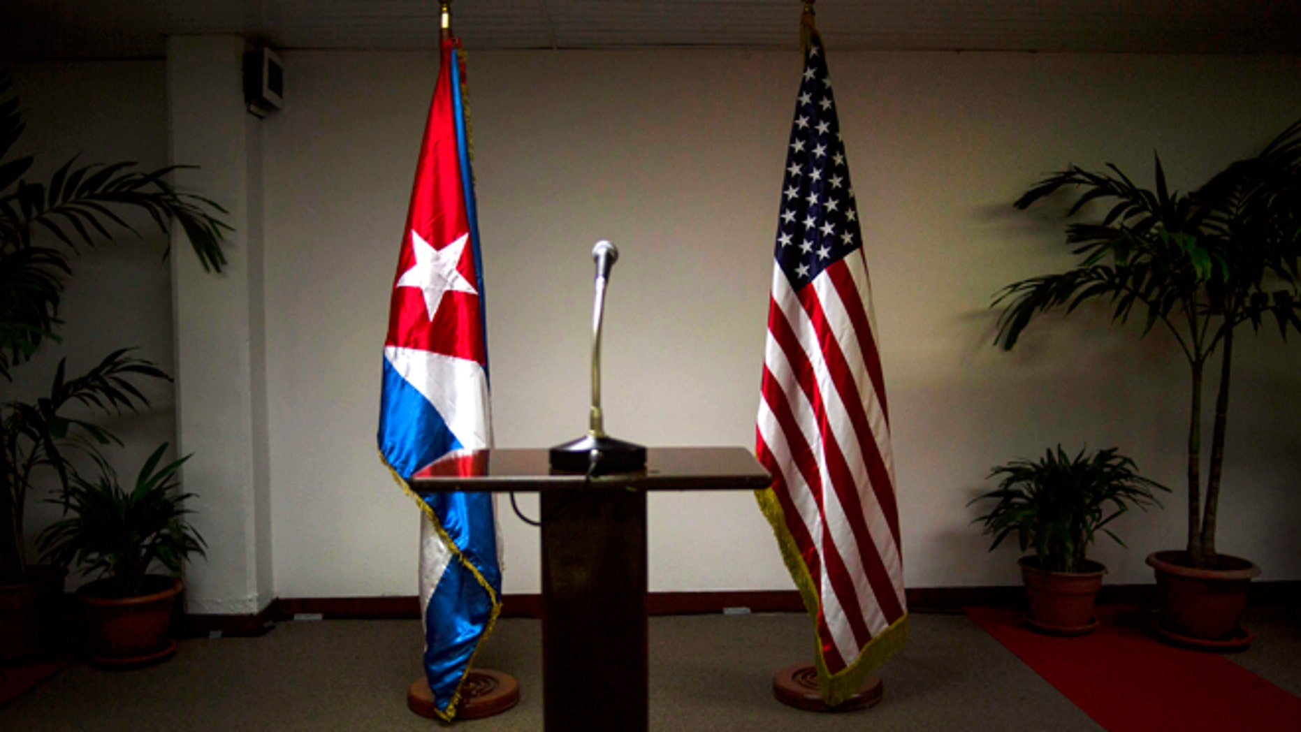 FILE - In this Jan. 22, 2015 file photo, Cuban and U.S. flags stand before the start of a press conference on the sidelines of talks between the two nations in Havana, Cuba. Members of the U.S. Democratic congressional delegation to Cuba said on Tuesday, Feb. 17, 2015 the next round of negotiations on restoring full diplomatic ties with Cuba will take place in Washington next week. (AP Photo/Ramon Espinosa, File)