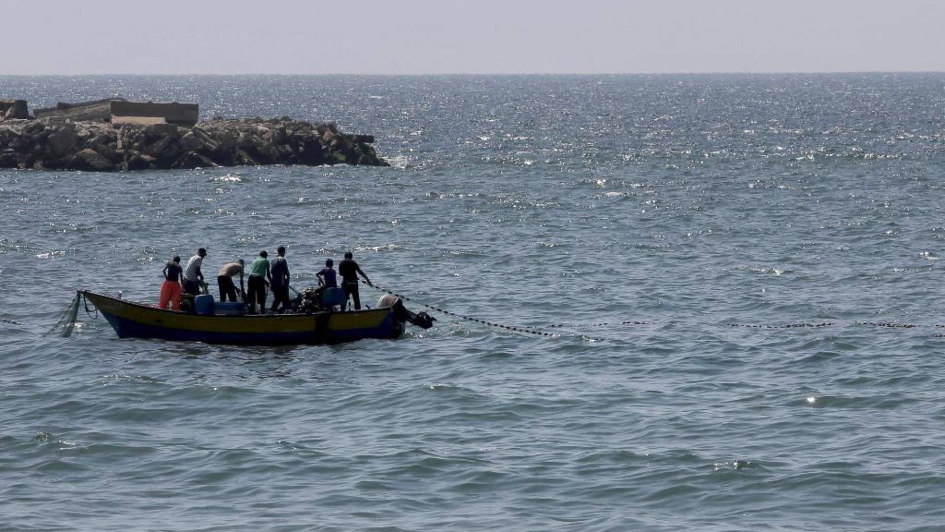 Aug. 7, 2014: Palestinian fishermen pull their fishnet at the Mediterranean Sea in Gaza City in the northern Gaza Strip. (AP)