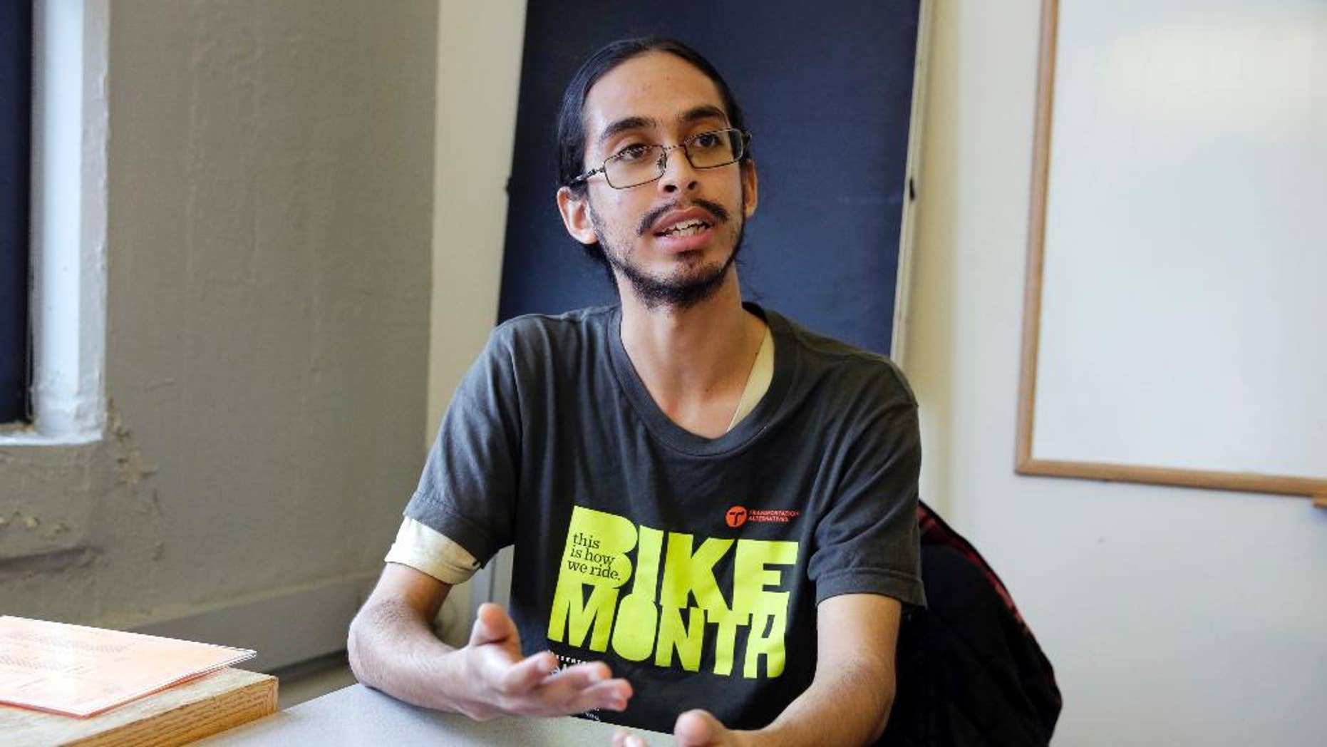 Samuel Santaella, 23, from the Queens borough of New York, speaks during an interview the offices of Riders Alliance, in New York, Wednesday, Nov. 30, 2016.  The Riders Alliance,  a commuter advocacy group, along with the anti-poverty group Community Service Society of New York, has been calling on Democratic Mayor Bill de Blasio to include an estimated $200 million in the city's preliminary budget plan this January that would help pay for discounted subway and bus rides.  (AP Photo/Richard Drew)