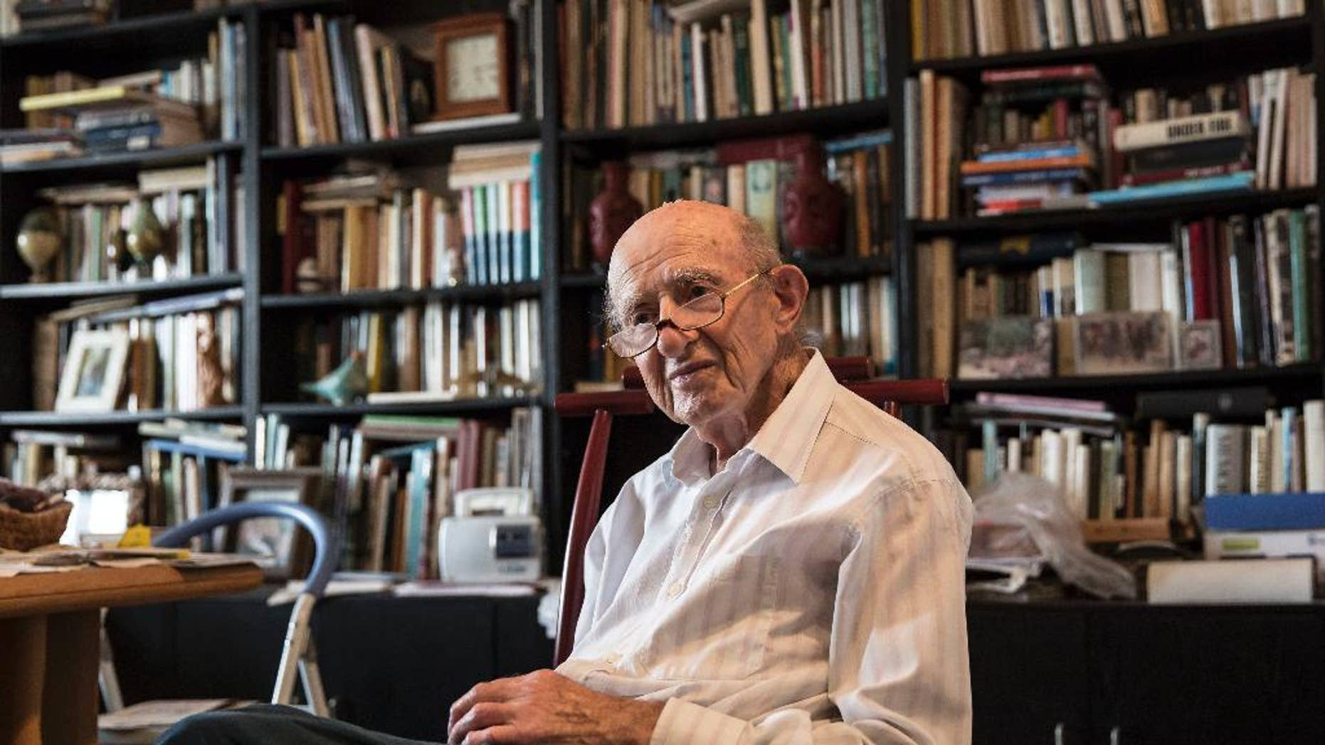 """File - In this file photo made on Monday, May 23, 2016, Joseph Harmatz sits during an interview with the Associated Press at his apartment in Tel Aviv, Israel. Harmatz, a Holocaust survivor who led the most daring attempt of Jews to seek revenge against their former Nazi tormentors, has died. He was 91. Harmatz was one of the few remaining Jewish """"Avengers"""" who carried out a mass poisoning of former SS men in an American prisoner-of-war camp in 1946 after World War II. The poisoning sickened more than 2,200 Germans but ultimately caused no known deaths.(AP Photo /Tsafrir Abayov, File)"""