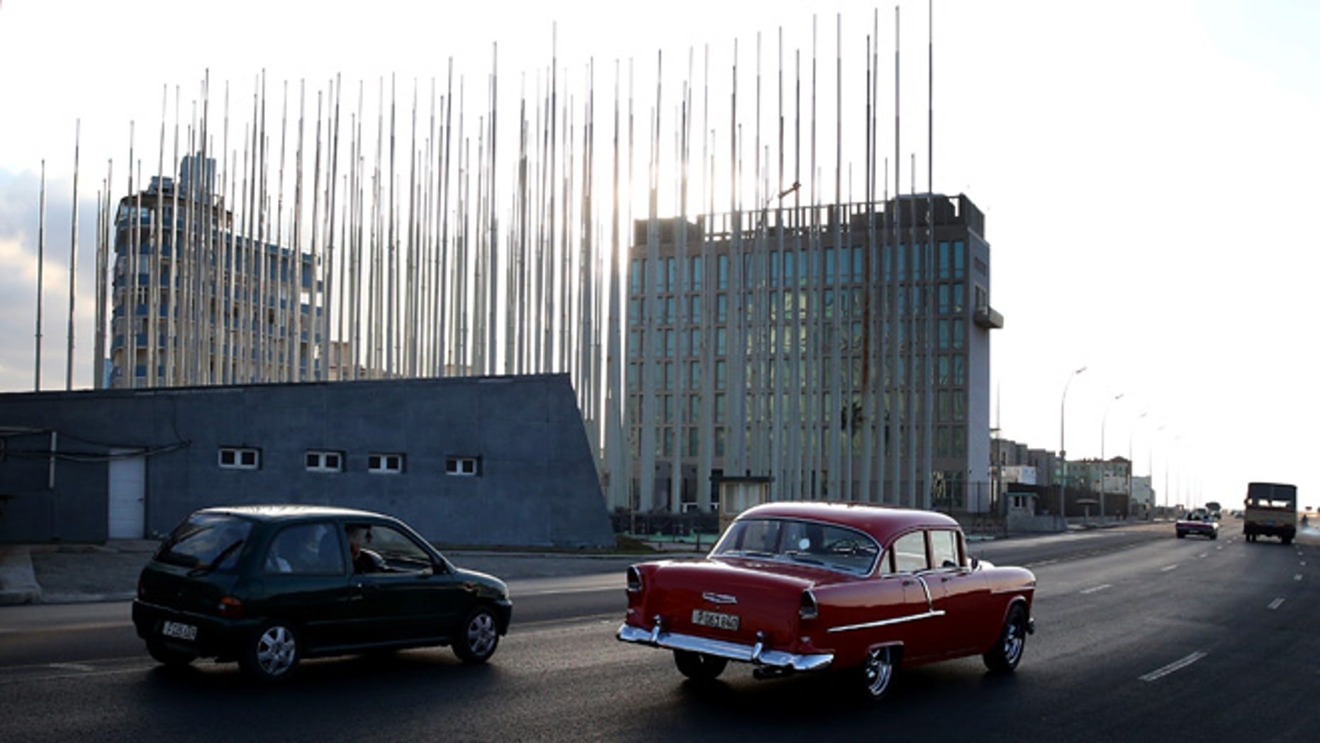 HAVANA, CUBA - FEBRUARY 25: Flag poles are seen in front of the United States Interests Section as Cuba and the U.S. governments prepare for the second round of discussions to restore diplomatic relations on February 25, 2015 in Havana, Cuba. Among the discussions scheduled for Friday will be converting the Interests Section back to a U.S. Embassy. (Photo by Joe Raedle/Getty Images)
