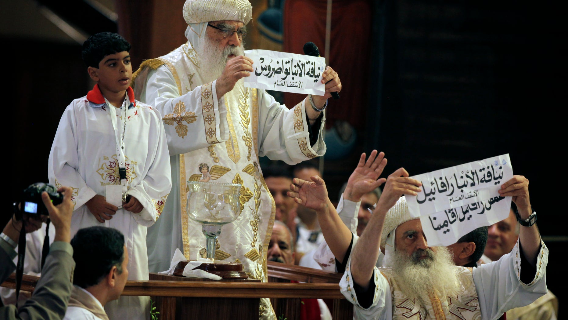 Coptic Christians in Egypt, led by acting Coptic Pope Pachomios, center, say the nation doesn't do enough to protect them from discrimination inside and outside of the nation's borders. (AP)