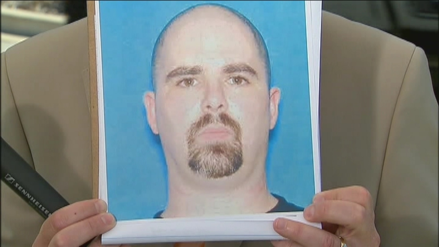 This photo released by authorities shows 40-year-old shooting suspect Wade Michael Page.