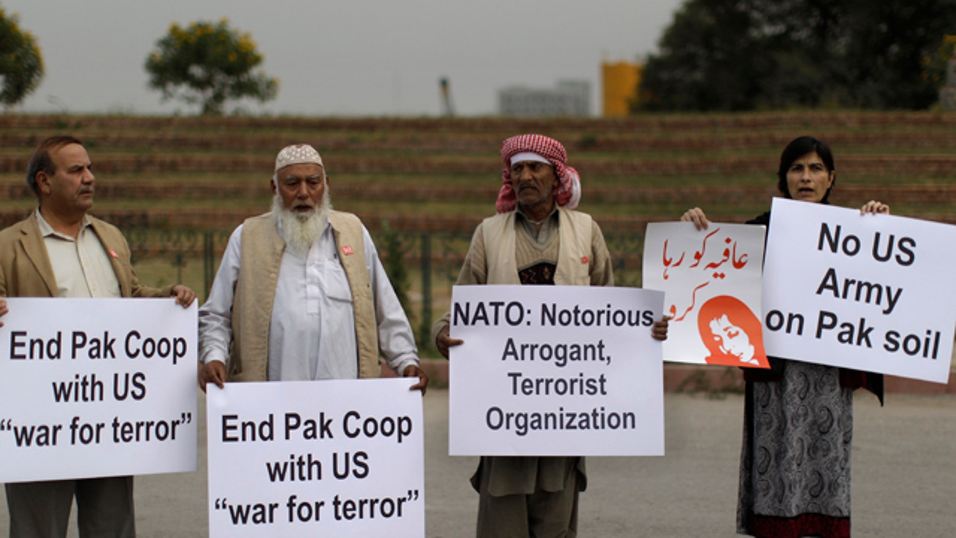 Dec. 1: Pakistanis hold placards and chant slogans during a protest to condemn NATO helicopters attacks on Pakistani troops, in Islamabad, Pakistan.