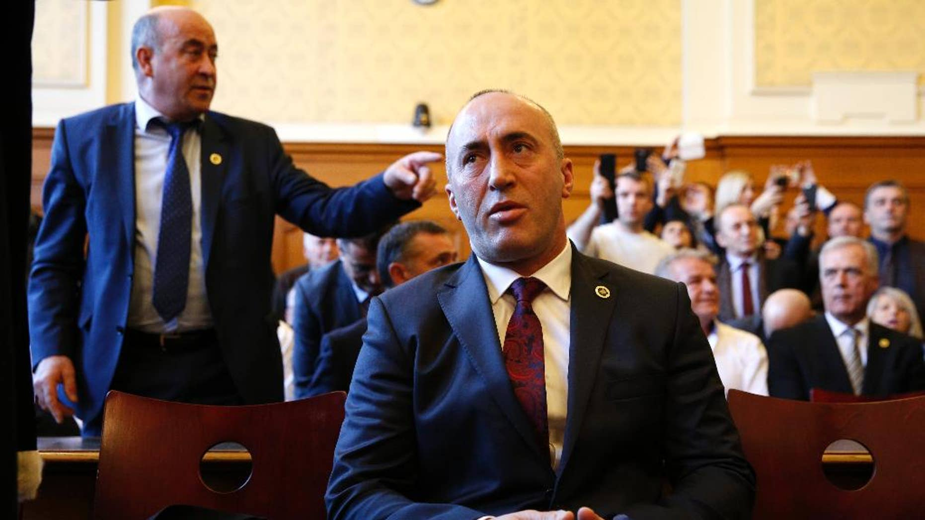 FILE - In this Thursday, March 2, 2017 file photo, Ramush Haradinaj, a former Kosovo prime minister, appears in court in Colmar. Albania's president has granted citizenship to the former prime minister of Kosovo. Nishani on Monday, April 24, 2017 issued a decree granting Albanian citizenship to Haradinaj and his wife Anita. (AP Photo/Jean-Francois Badias, File)