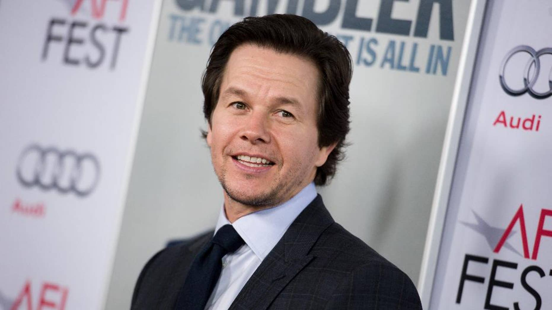 "FILE - In this Nov. 10, 2014 file photo, Mark Wahlberg arrives at the 2014 AFI Fest - ""The Gambler,"" in Los Angeles. Wahlberg, along with Scott Stuber, Dylan Clark, Stephen Levinson and Michael Radutzky, will produce ""Patriots' Day,"" a film chronicling the events surrounding the 2013 Boston Marathon Bombing, based on the first-hand account of Boston Police Commissioner Ed Davis. Matt Charman is writing the screenplay and Nicholas Nesbitt will executive produce. (Photo by Richard Shotwell/Invision/AP, File)"