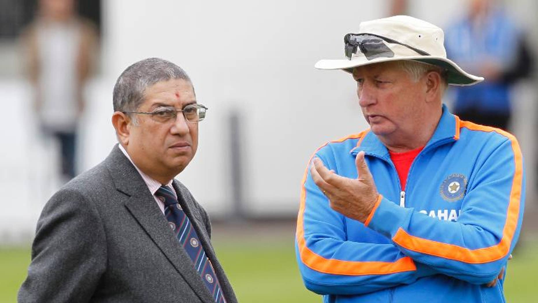 Narayanaswami Srinivasan (L), Secretary of the Board of Control for Cricket in India (BCCI), talks with India's coach Duncan Fletcher during a training session at Lord's Cricket Ground in London, on July 20, 2011.