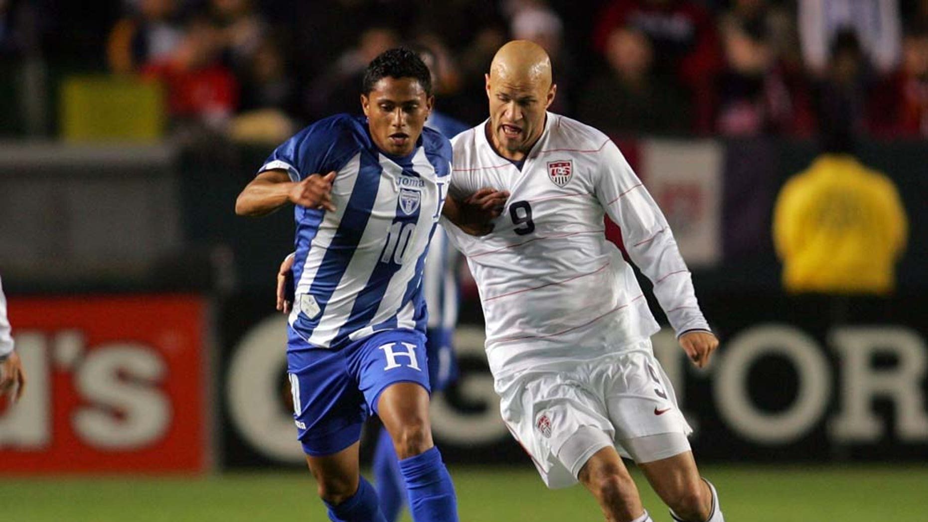 CARSON, CA - JANUARY 23:  Ramon Nunez #10 of Honduras holds off a challenge by Conor Casey #9 of USA during their international friendly match on January 23, 2010 in Carson, California. Honduras defeated USA 3-1.  (Photo by Victor Decolongon/Getty Images)