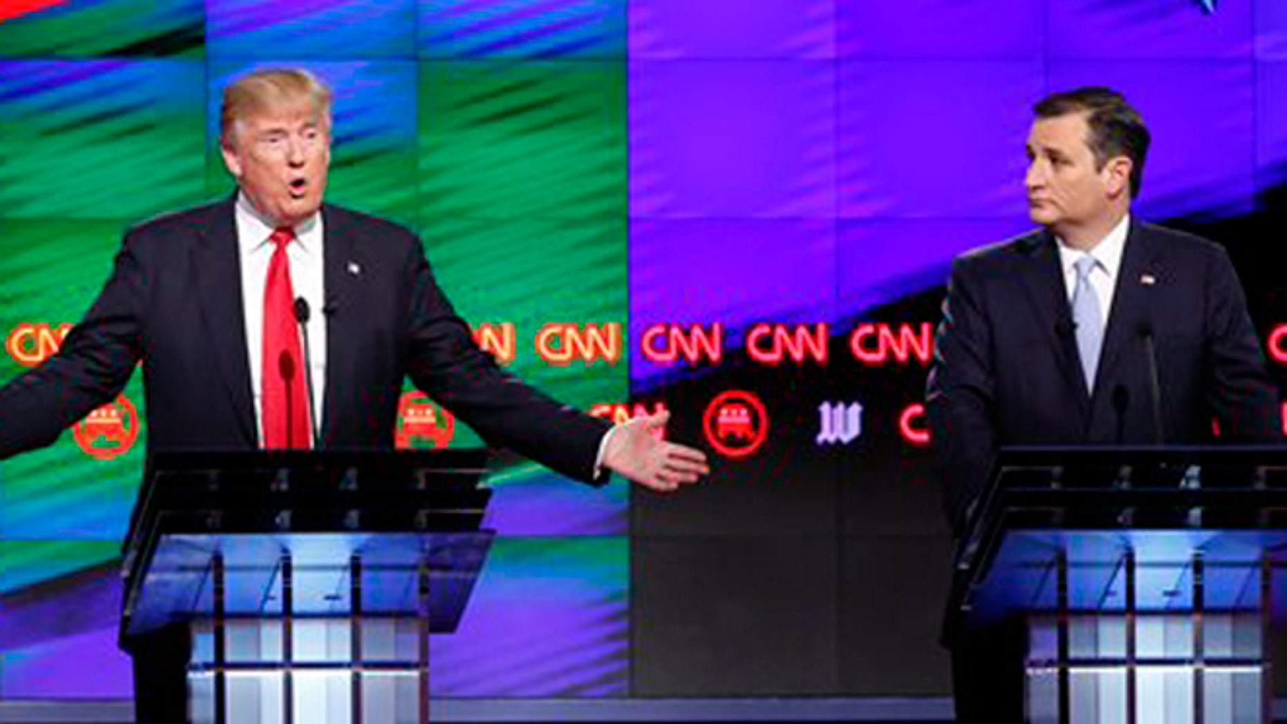 Republican presidential candidate, businessman Donald Trump  answers a question, as Republican presidential candidate, Sen. Ted Cruz, R-Texas, , listens, during the Republican presidential debate sponsored by CNN, Salem Media Group and the Washington Times at the University of Miami,  Thursday, March 10, 2016, in Coral Gables, Fla. (AP Photo/Wilfredo Lee)