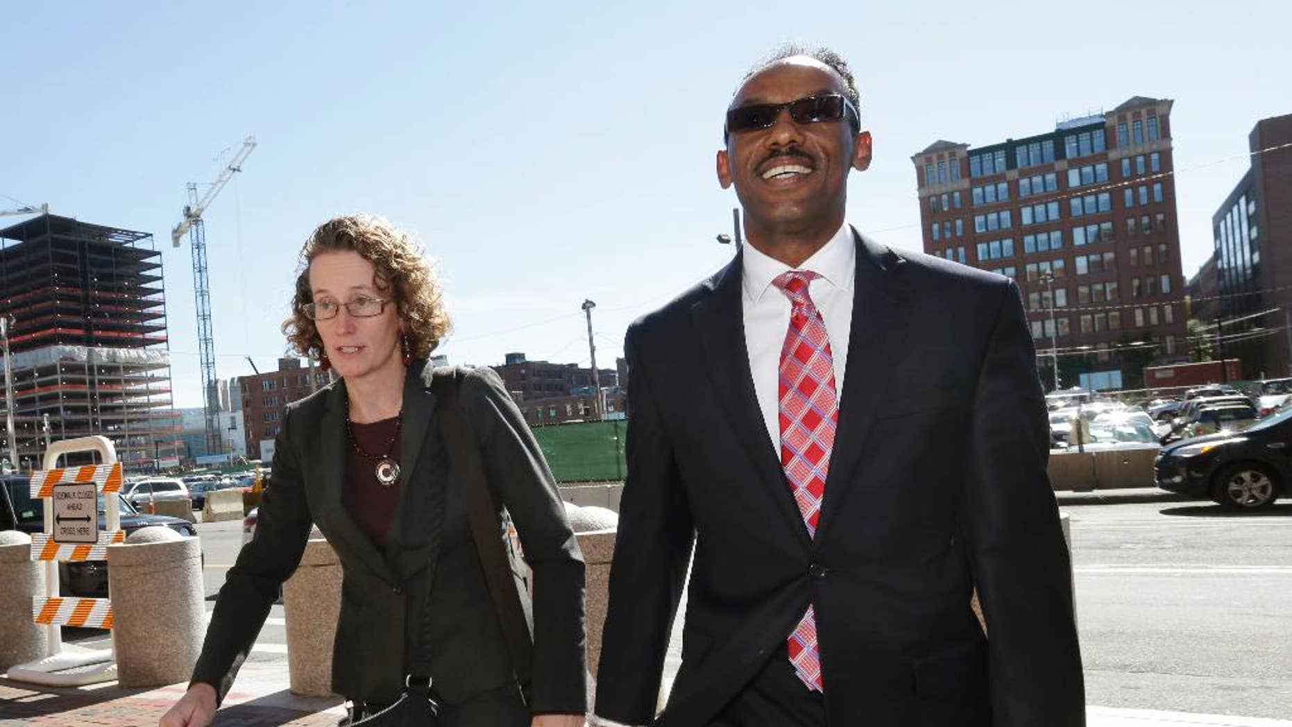 Attorneys for Robel Phillipos, Susan Church, left, and Derege Demissie, arrive at federal court Tuesday, Sept. 23, 2014, in Boston. Phillipos, 21, of Cambridge, Mass., a college friend of Boston Marathon bombing suspect Dzhokhar Tsarnaev, is charged with lying to authorities investigating the bombing. A judge on Tuesday denied a motion to move next week's trial for Phillipos. Jury selection is set to begin Monday in U.S. District Court. Opening statements are scheduled for Oct. 6.  (AP Photo/Steven Senne)