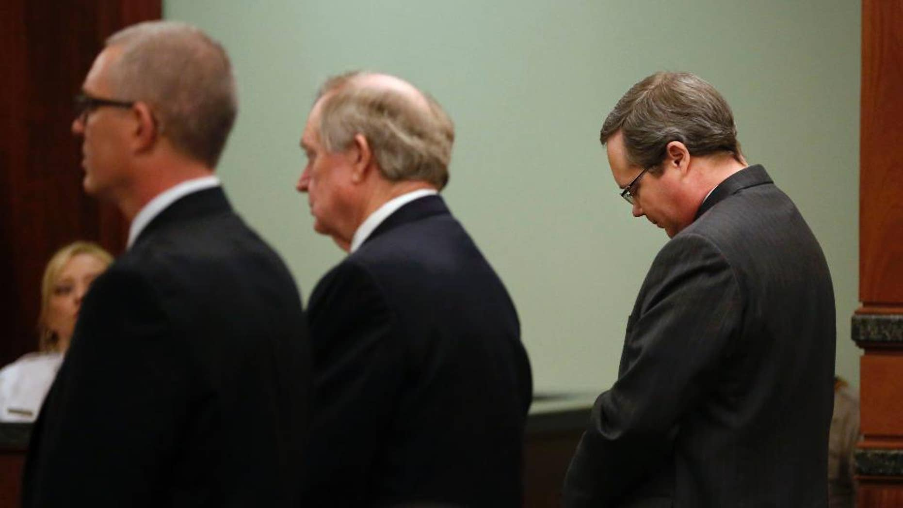 Eric Williams lowers his head as a guilty verdict is read during his capital murder trial at the Rockwall County Courthouse in Rockwall, Texas, on Thursday, Dec. 4, 2014.  The jury convicted Williams, a former public official, in the 2013 murder of Cynthia McLelland and her husband Kaufman County District Attorney Mike McLelland.  Williams now faces a potential death sentence.   (AP Photo/The Dallas Morning News, Pool)