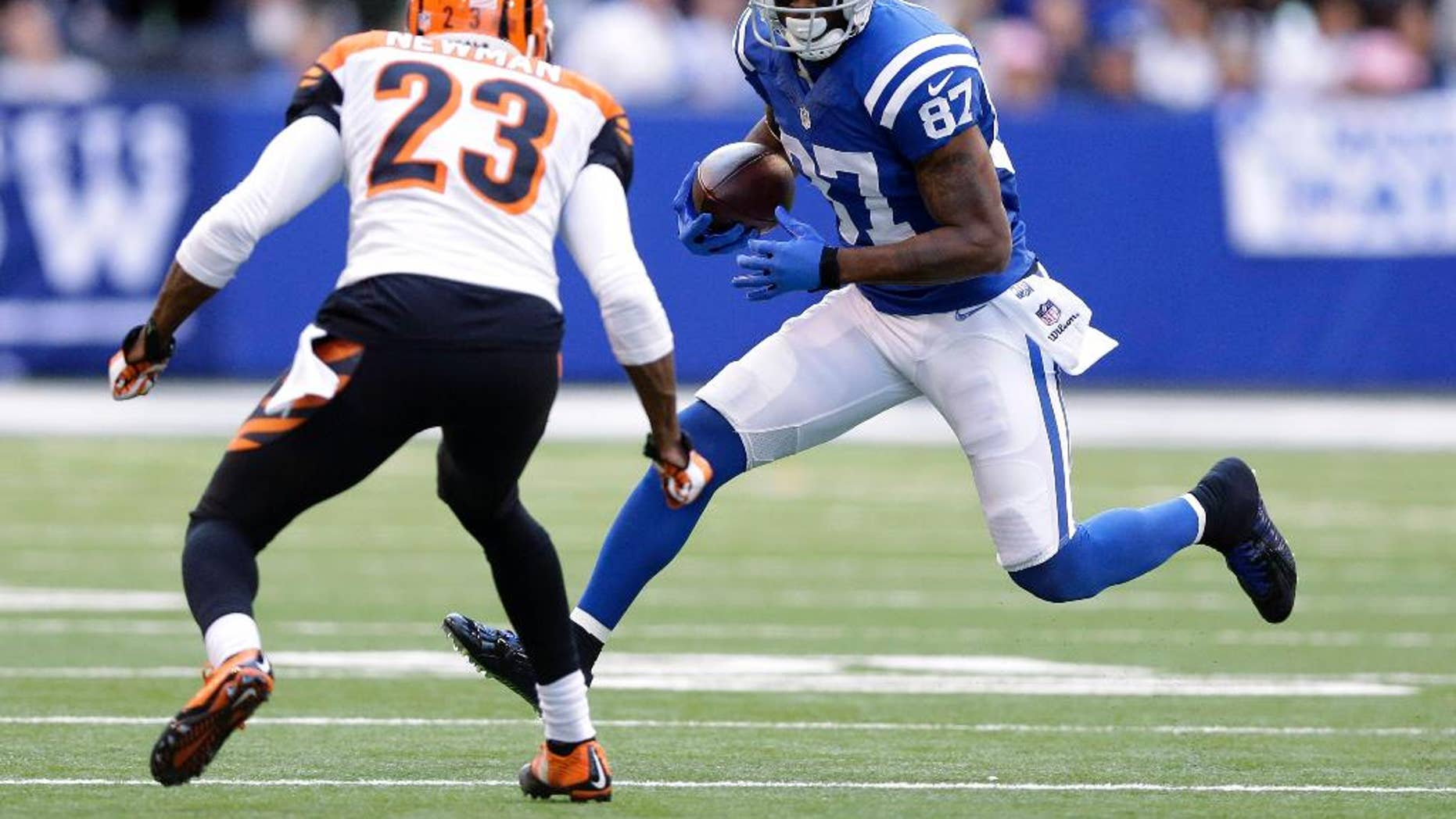 Indianapolis Colts wide receiver Reggie Wayne (87) runs against Cincinnati Bengals cornerback Terence Newman (23) during the second half of an NFL football game Sunday, Oct. 19, 2014, in Indianapolis. (AP Photo/Michael Conroy)