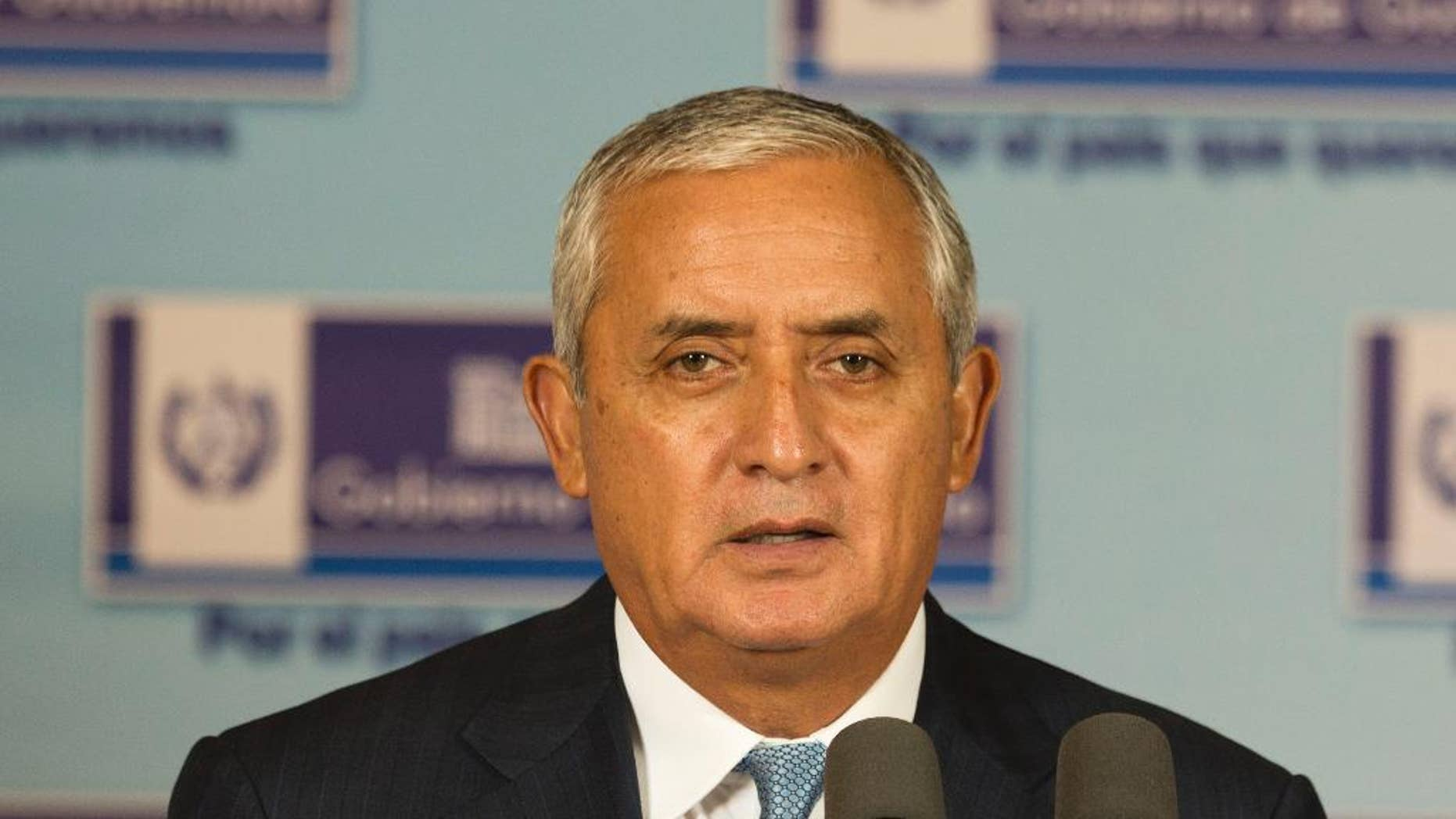 In this April 23, 2015 photo, Guatemala's President Otto Perez Molina gives a press conference at the National Palace in Guatemala City. Guatemala's Supreme Court has given the go-ahead for congress to decide whether to remove President Otto Perez Molina's immunity from prosecution in a corruption scandal. (AP Photo/Moises Castillo)
