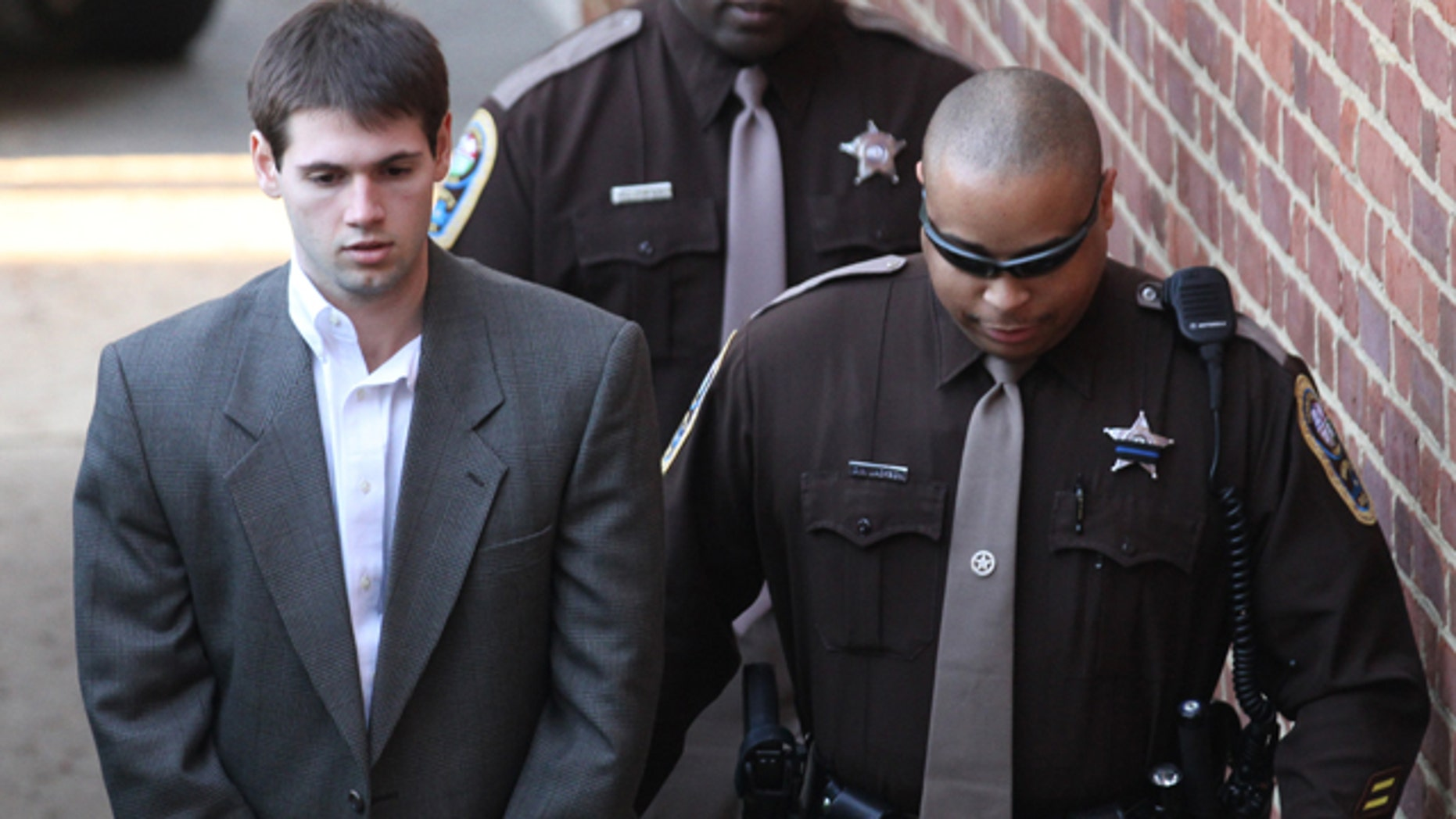 Feb. 10: George Huguely V is escorted to the Charlottesville Circuit Court.