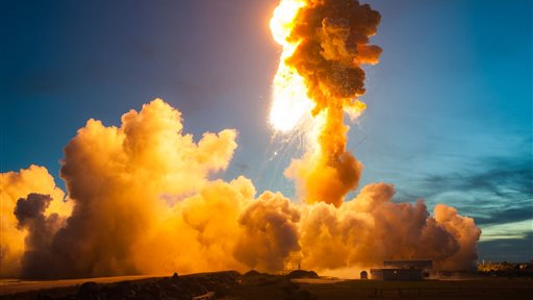 This Tuesday Oct 28, 2014 photo provided by NASA shows the Orbital Antares rocket, after it suffered a catastrophic anomaly moments after launch at NASA's Wallops Flight Facility in Virginia.  The Cygnus spacecraft was filled with supplies slated for the International Space Station, including science experiments, experiment hardware, spare parts, and crew provisions. (Joel Kowsky/NASA via AP)