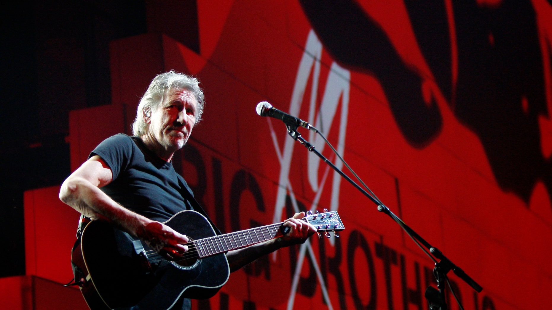 """FILE - In this April 1, 2011 file photo, Roger Waters performs during his """"The Wall Tour 2010/2011"""" in Milan, Italy. Now that his three-year world tour for """"The Wall"""" has finally come to an end, Waters wants to set the record straight over criticism he's received from Jewish groups regarding his use of the Star of David symbol in the show and his support for a cultural boycott of Israel. (AP Photo/Antonio Calanni, File)"""