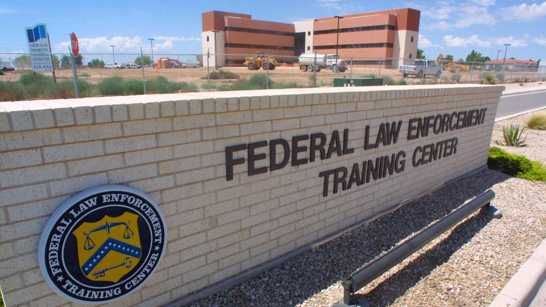 FILE - In this Aug. 1, 2002 file photo, the Federal Law Enforcement Training Center in Artesia, N.M., where agents for the Federal Air Marshal Service undergo training. Incidents of unruly passengers on planes are increasing, and more effective deterrents are needed to tackle the problem, a global airline trade group said Wednesday, Sept. 28, 2016. There were 10,854 air rage incidents reported by airlines worldwide last year, up from 9,316 incidents in 2014, according to the International Air Transport Association. That equates to one incident for every 1,205 flights, an increase from one incident per 1,282 flights the previous year.  (AP Photo/J.R. Hernandez, File)