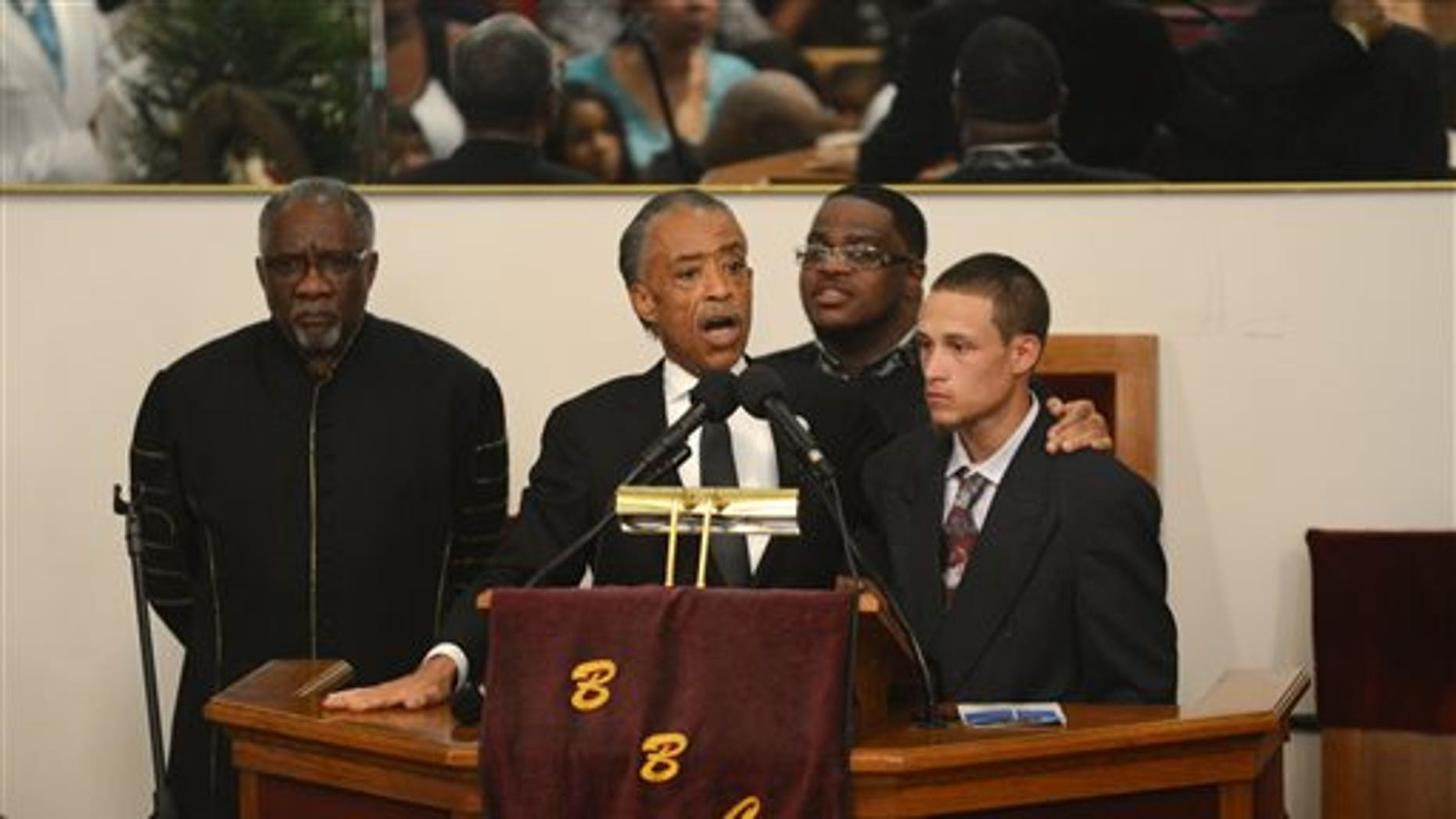 The Rev. Al Sharpton introduces Ramsey Orta at the funeral of Eric Garner at Bethel Baptist Church in the Brooklyn borough of New York on Wednesday, July 23, 2014. Garner died in police custody after an officer placed him in an apparent chokehold. Orta shot video of the incident. (AP Photo/New York Daily News, Julia Xanthos, Pool)