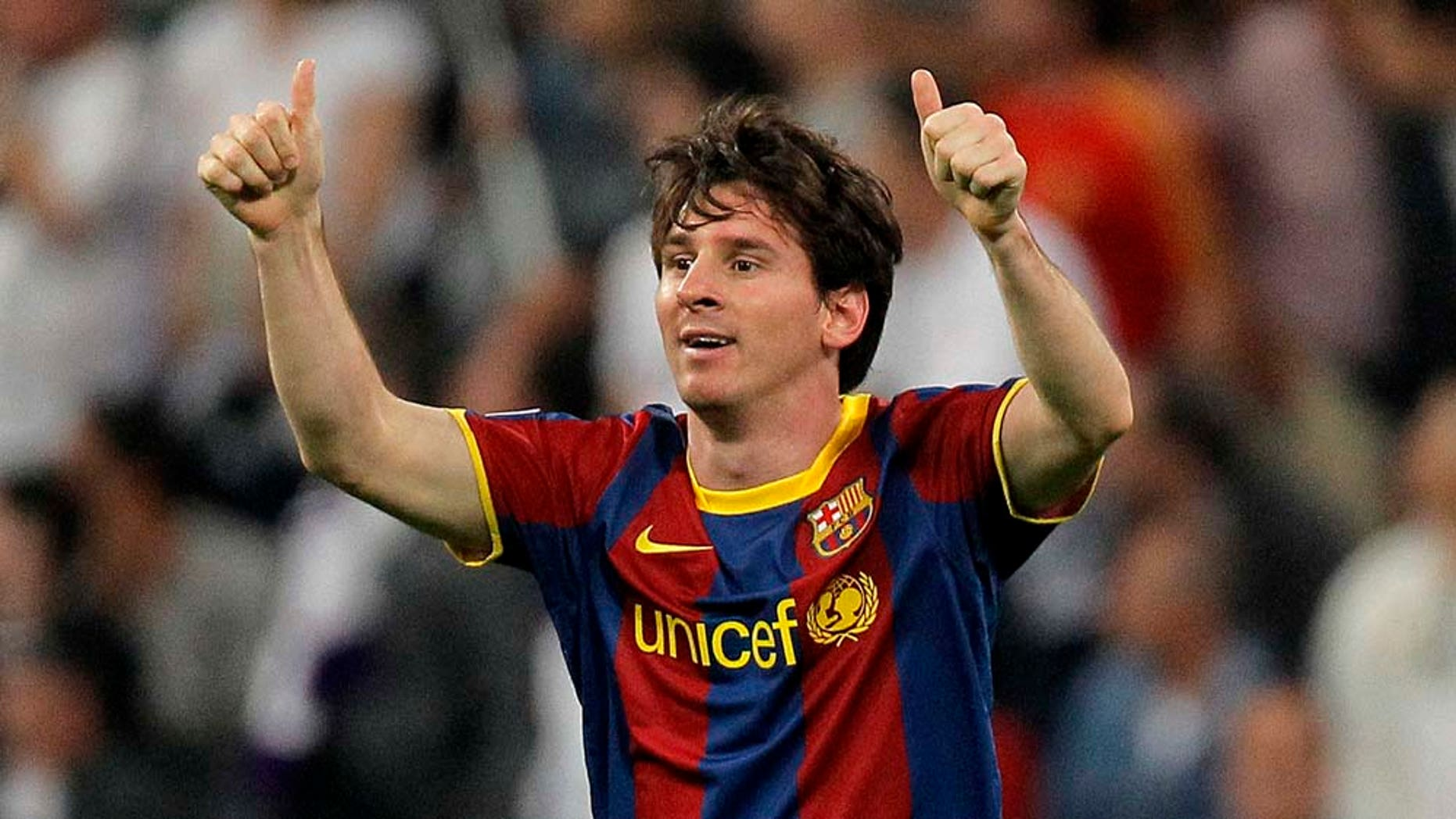 Apr 27: FC Barcelona's Lionel Messi from Argentina celebrates his goal during a semifinal, 1st leg Champions League soccer match against  Real Madrid at the Santiago Bernabeu stadium in Madrid.