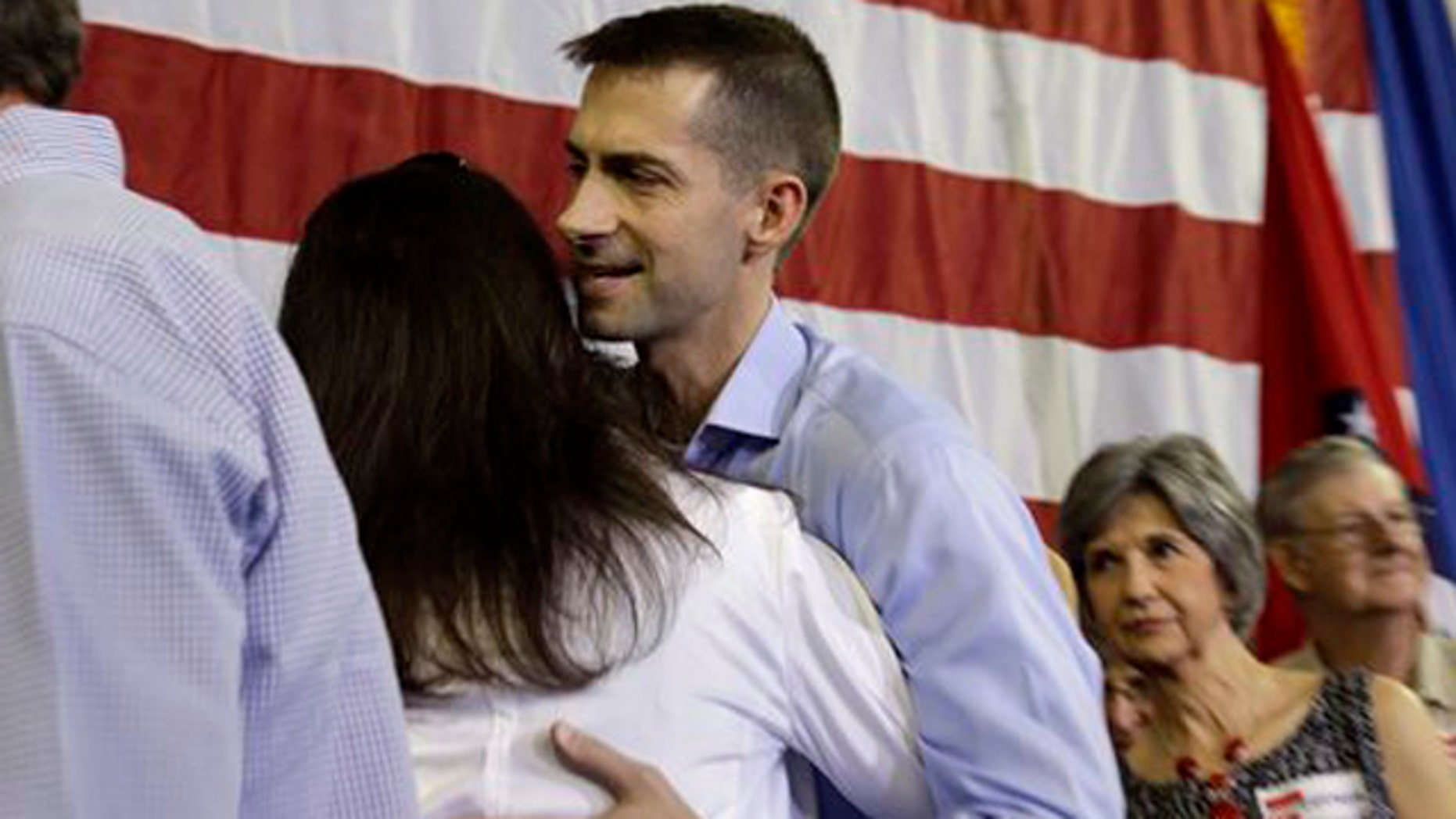 FILE: Aug. 6, 2013: Rep. Tom Cotton, R-Ark., center, greets a supporter after announcing his candidacy for Senate, in Dardanelle, Ark.