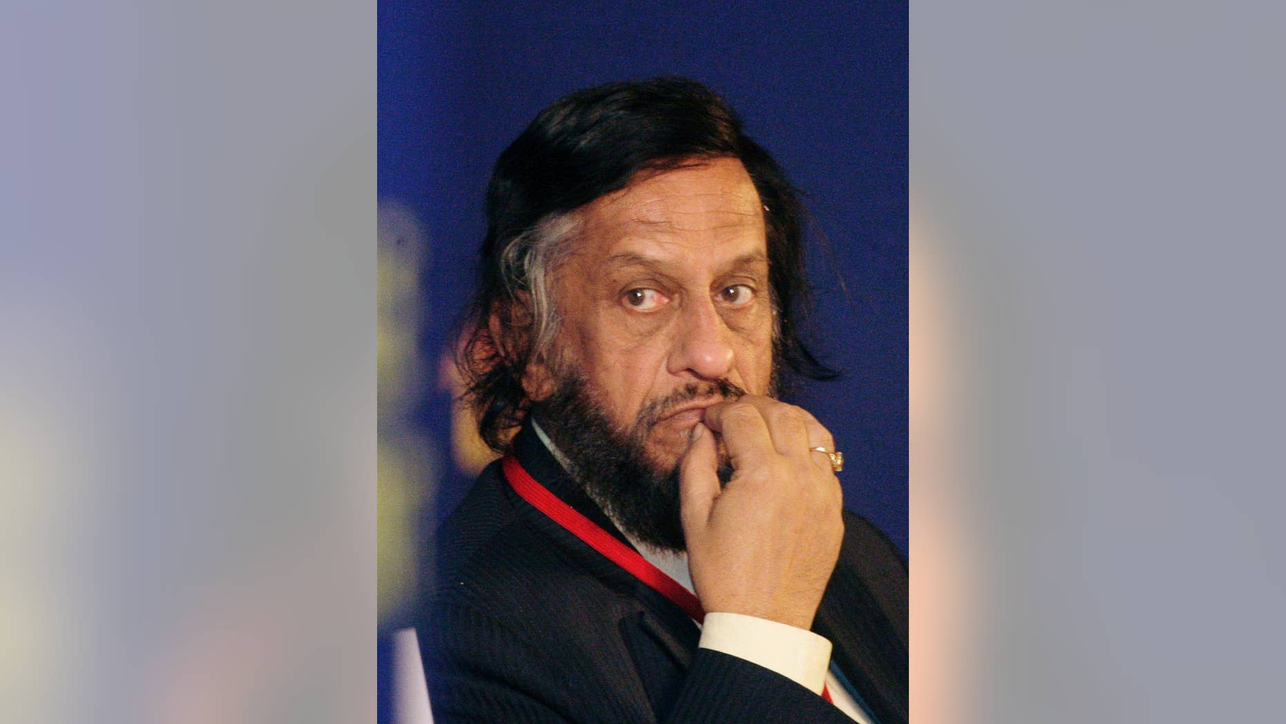 FILE- In this Feb. 6, 2010 file photo,Intergovernmental Panel on Climate Change Chairman Rajendra Pachauri listens to a speaker at the Delhi Sustainable Development Summit in New Delhi, India. A court in India's capital says there's enough evidence in a stalking and sexual harassment case for a former chairman of the U.N.'s climate body, Rajendra Pachauri, to stand trial. (AP Photo/Gurinder Osan, file)