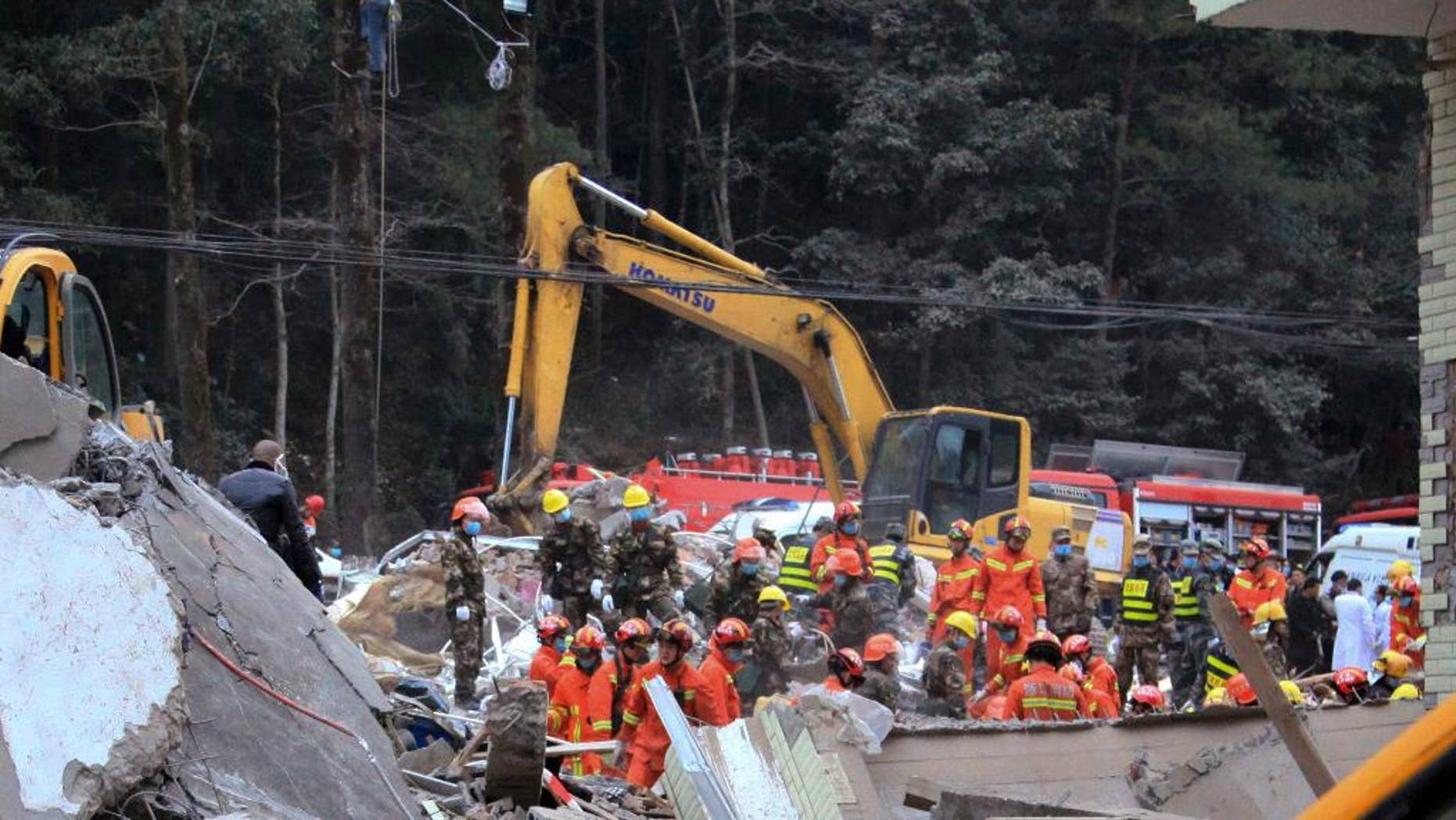 Rescuers search for survivors at the site of collapsed homes in Dahui village, Baizhangji township in Wencheng county in east China's Zhejiang province, Thursday, Feb. 2, 2017. Several people were buried in the collapse of a group of homes in eastern China on Thursday morning, a Chinese rescue official and state media reported. (Chinatopix via AP)