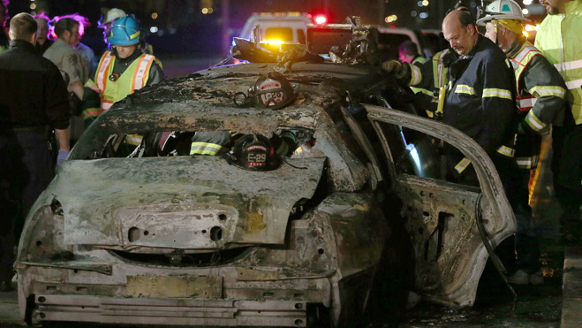 May 4, 2013: San Mateo County firefighters and California Highway Patrol personnel investigate the scene of a limousine fire on the westbound side of the San Mateo-Hayward Bridge in Foster City, Calif.