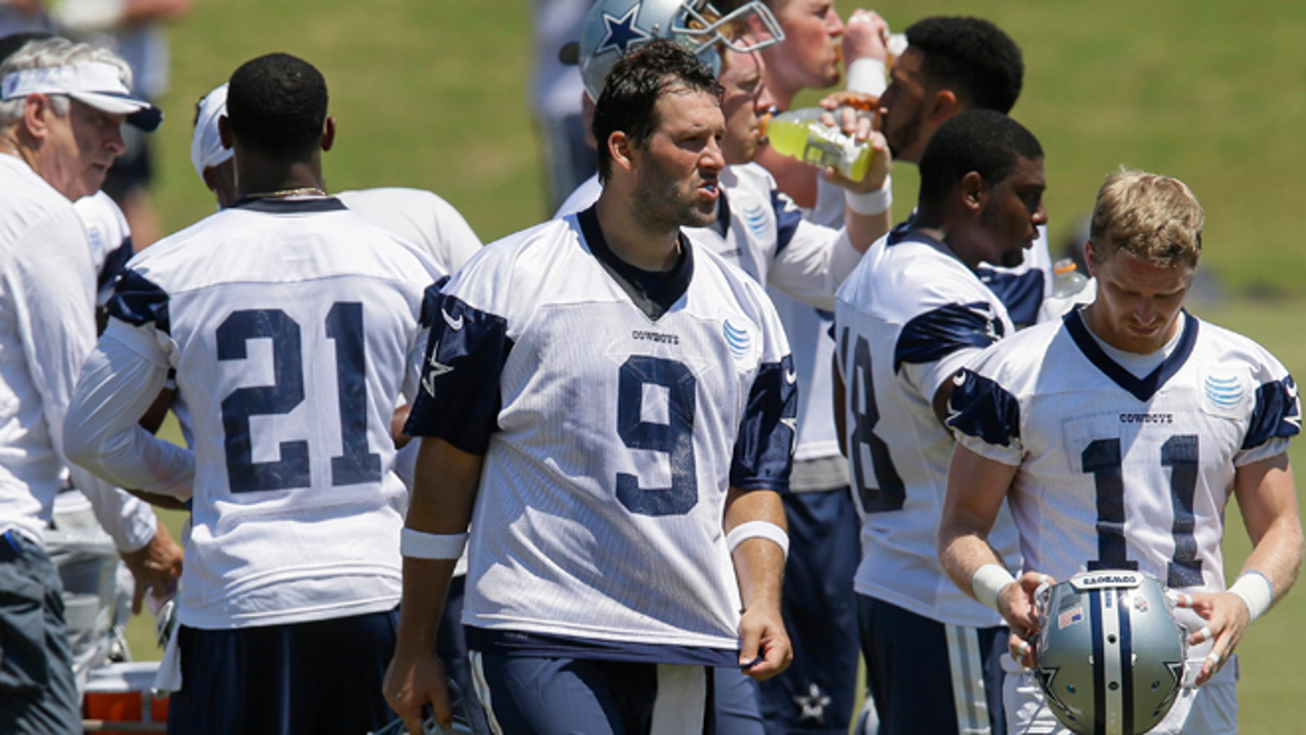 Dallas Cowboys quarterback Tony Romo (9) takes a break during an NFL football organized activity, Wednesday, June 10, 2015, in Irving, Texas. (AP Photo/Tim Sharp)