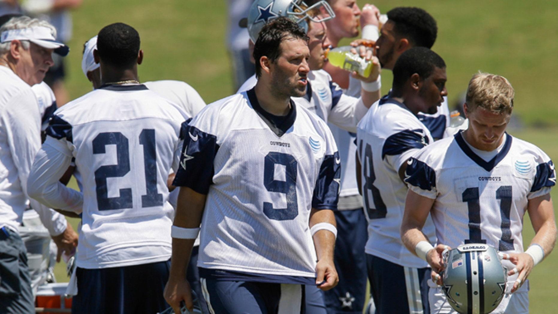 Dallas Cowboys quarterback Tony Romo (9) takes a break during an NFL football organized activity, Wednesday, June 10, 2015, in Irving, Texas. (AP Photo/Tim Sharp)