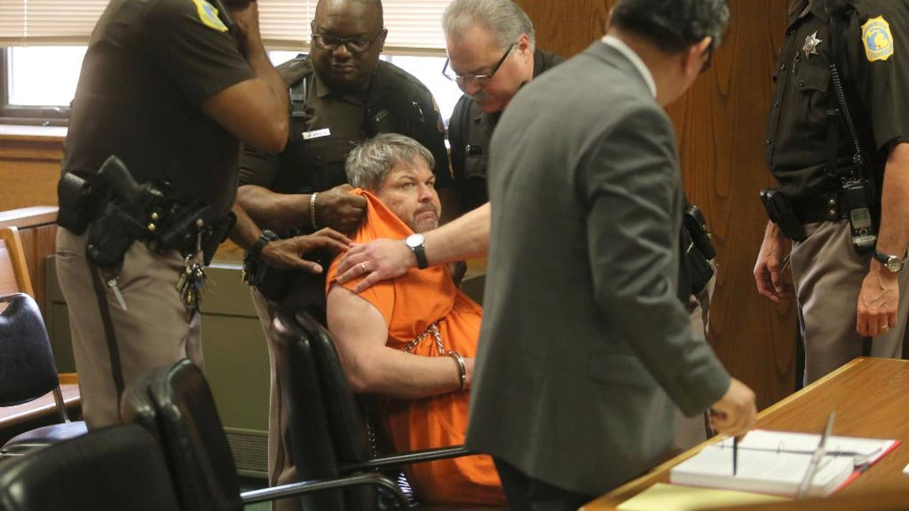Kalamazoo County Deputies try to remove Jason Dalton after an outburst during his preliminary examination in district court on Friday, May 20, 2016 in Kalamazoo, Mich. Prosecutors say Dalton gunned down six people and wounded two others in the Kalamazoo area over several hours on Feb. 20 while driving for Uber that night. ( Mark Bugnaski/Kalamazoo Gazette-MLive Media Group via AP, Pool)