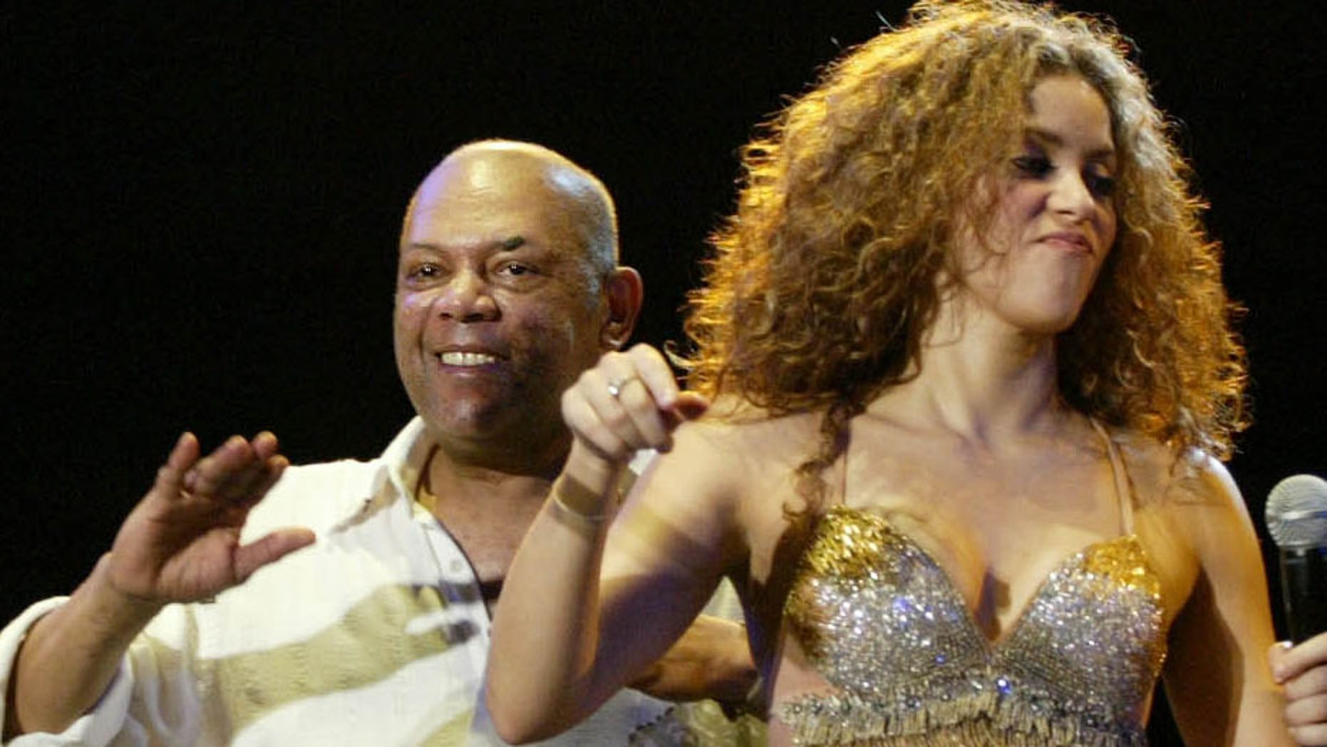 FILE- In this Nov. 15, 2006 file photo, Colombian pop singer Shakira performs with Joe Arroyo during her concert in Barranquilla, Colombia. The salsa singer died of complications following a hypertension crisis at a Barranquilla clinic. He was 55.  (AP Photo/William Fernando Martinez, File)