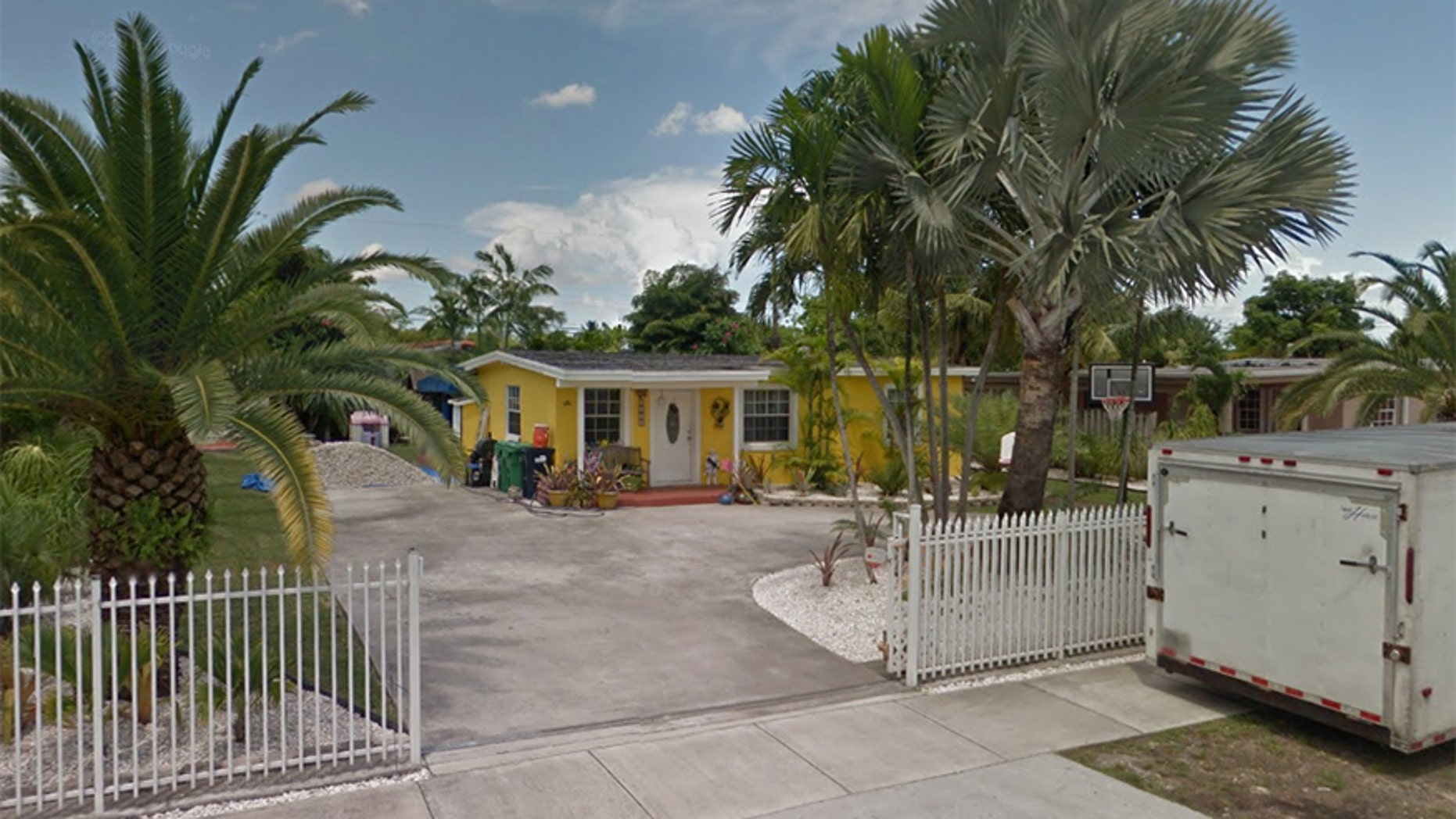 A 7-year-old girl was bit by her dog outside this home in Miami-Dade county.