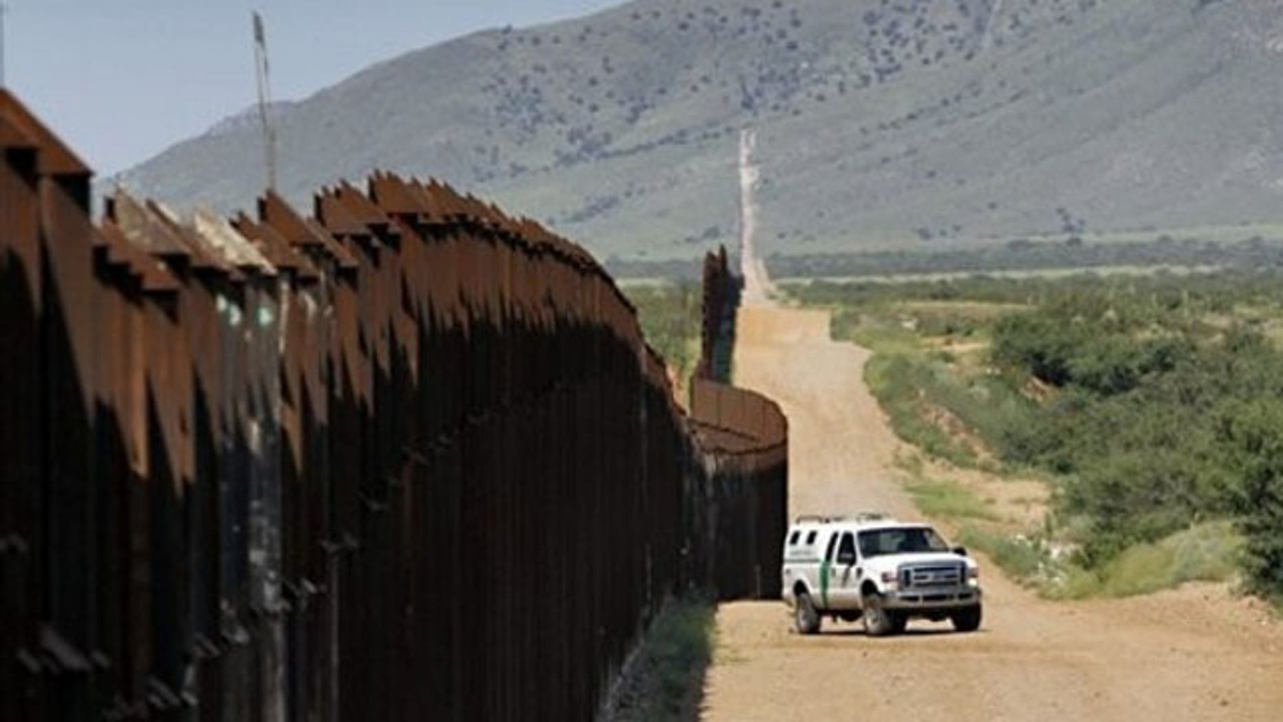 A U.S. Customs and Border Patrol agent patrols along the Arizona-Mexico border Aug. 15 in Hereford, Ariz. (AP Photo)