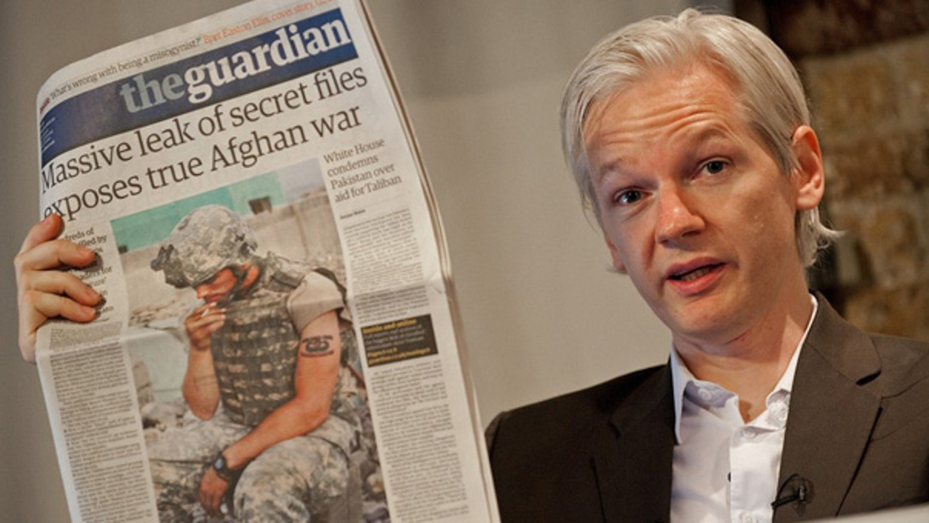 July 26: WikiLeaks founder Julian Assange holds up a copy of Britain's Guardian newspaper during a press conference in London.